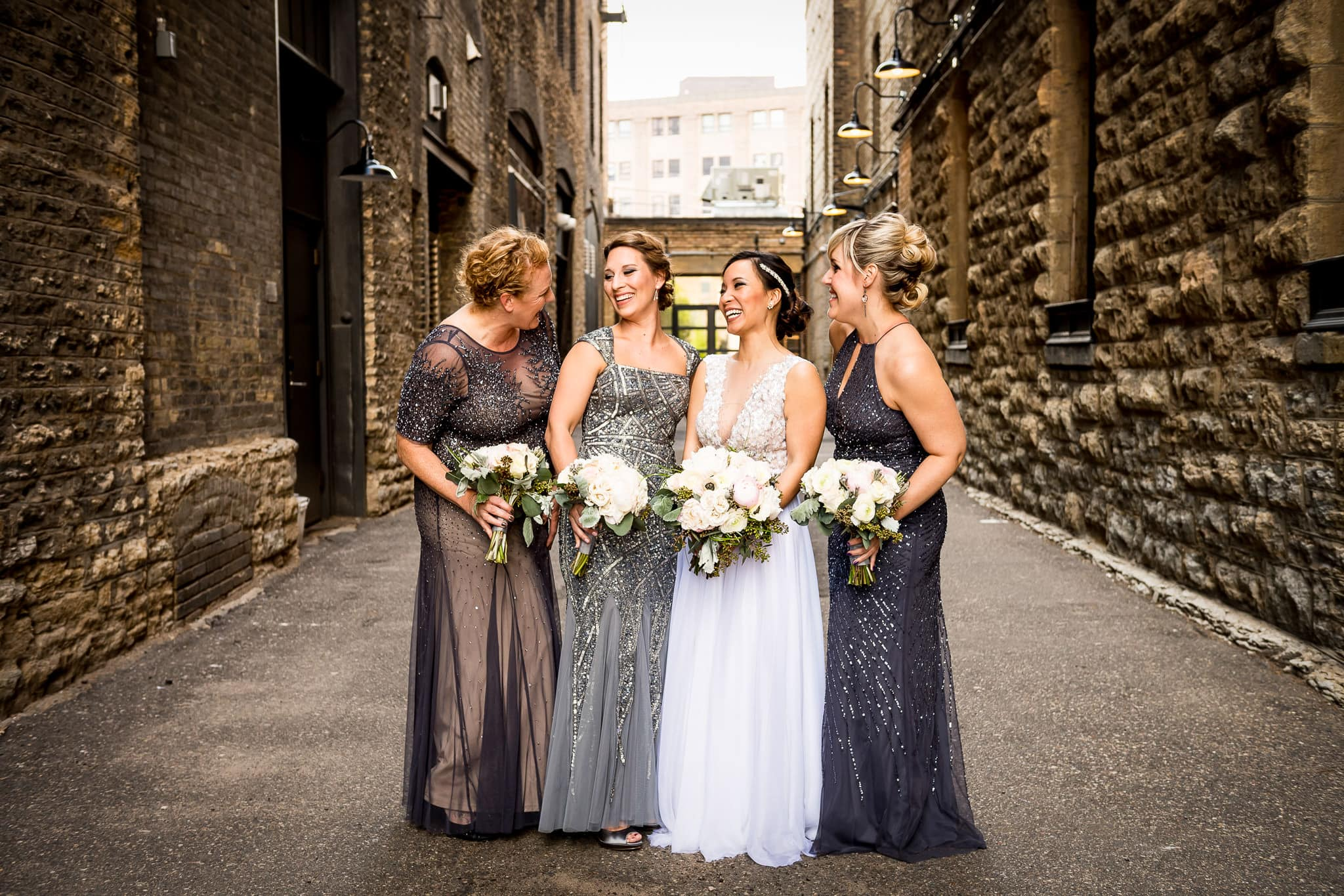 Bridesmaids laughing at the Hewing Hotel