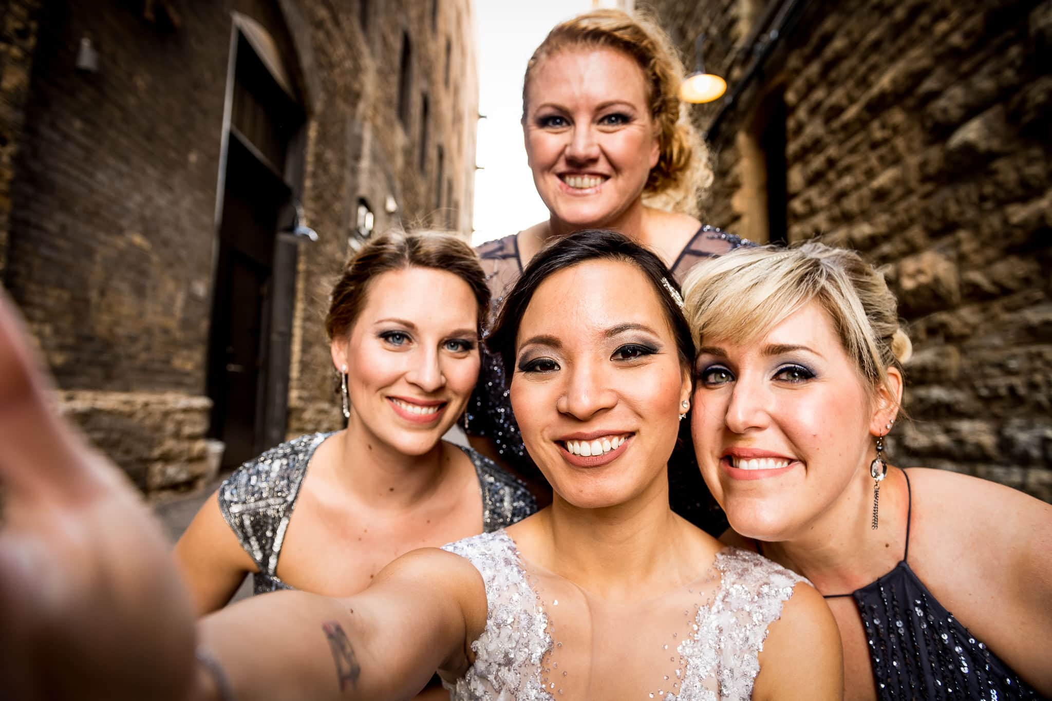 Hi-definition Bridesmaids selfie in the alley behind the Hewing Hotel