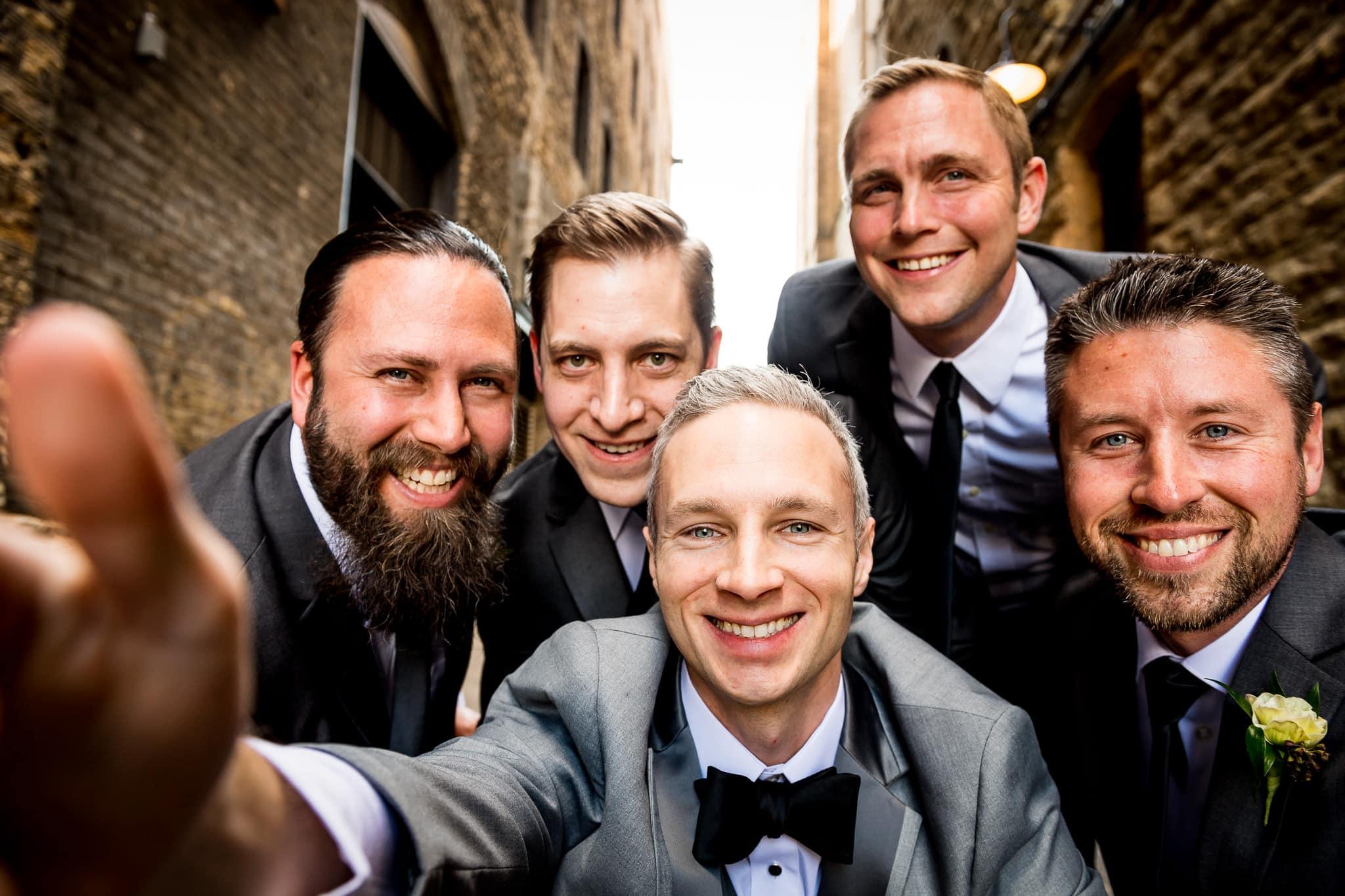 Hi-definition Grroomsen selfie in the alley behind the Hewing Hotel