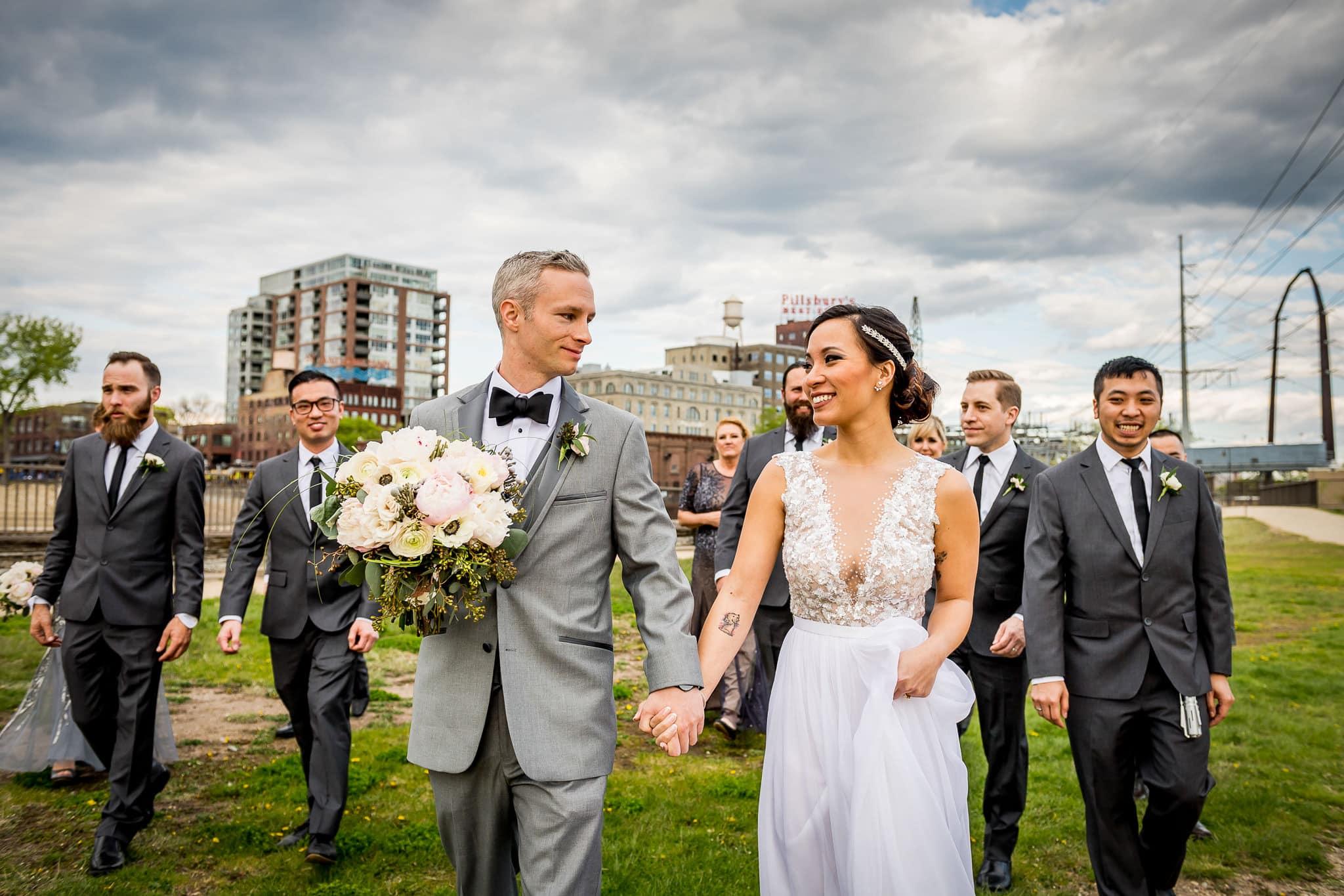 Wedding Party walking along Saint Anthony Main