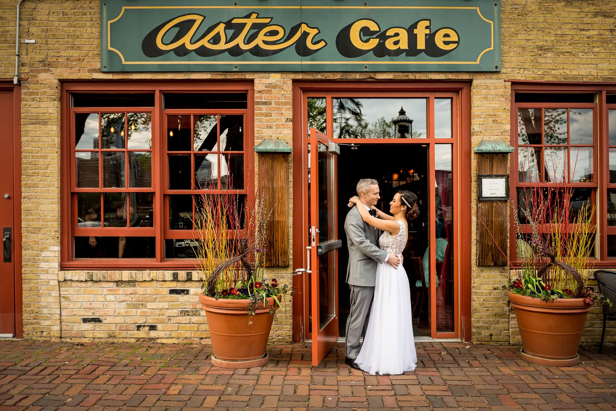 wedding photograph of couple standing just outside of Aster Cafe