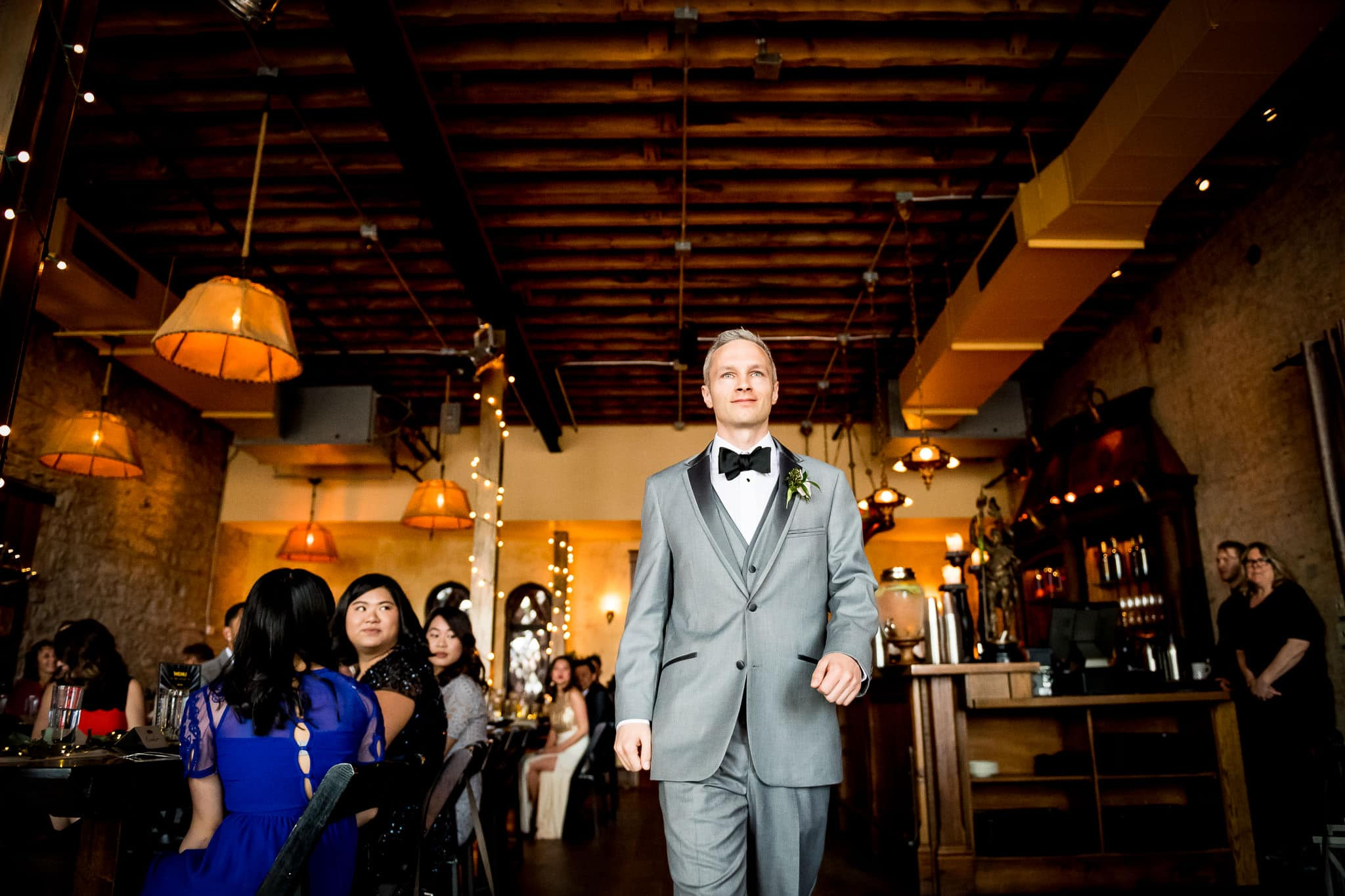 Aster Cafe wedding Photo of Groom walking down the aisle 2
