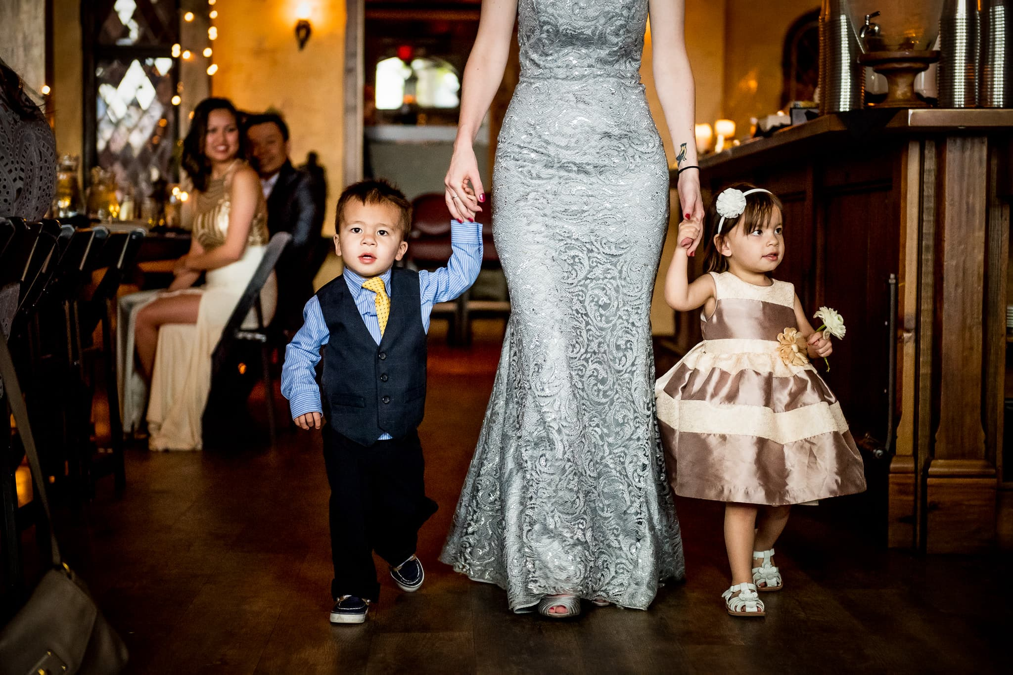 Aster Cafe wedding Photo of kids walking down the aisle 1