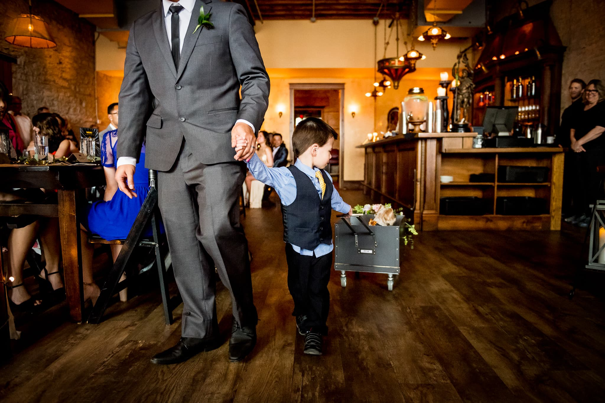 Aster Cafe wedding Photo of child and dog walking down the aisle 2