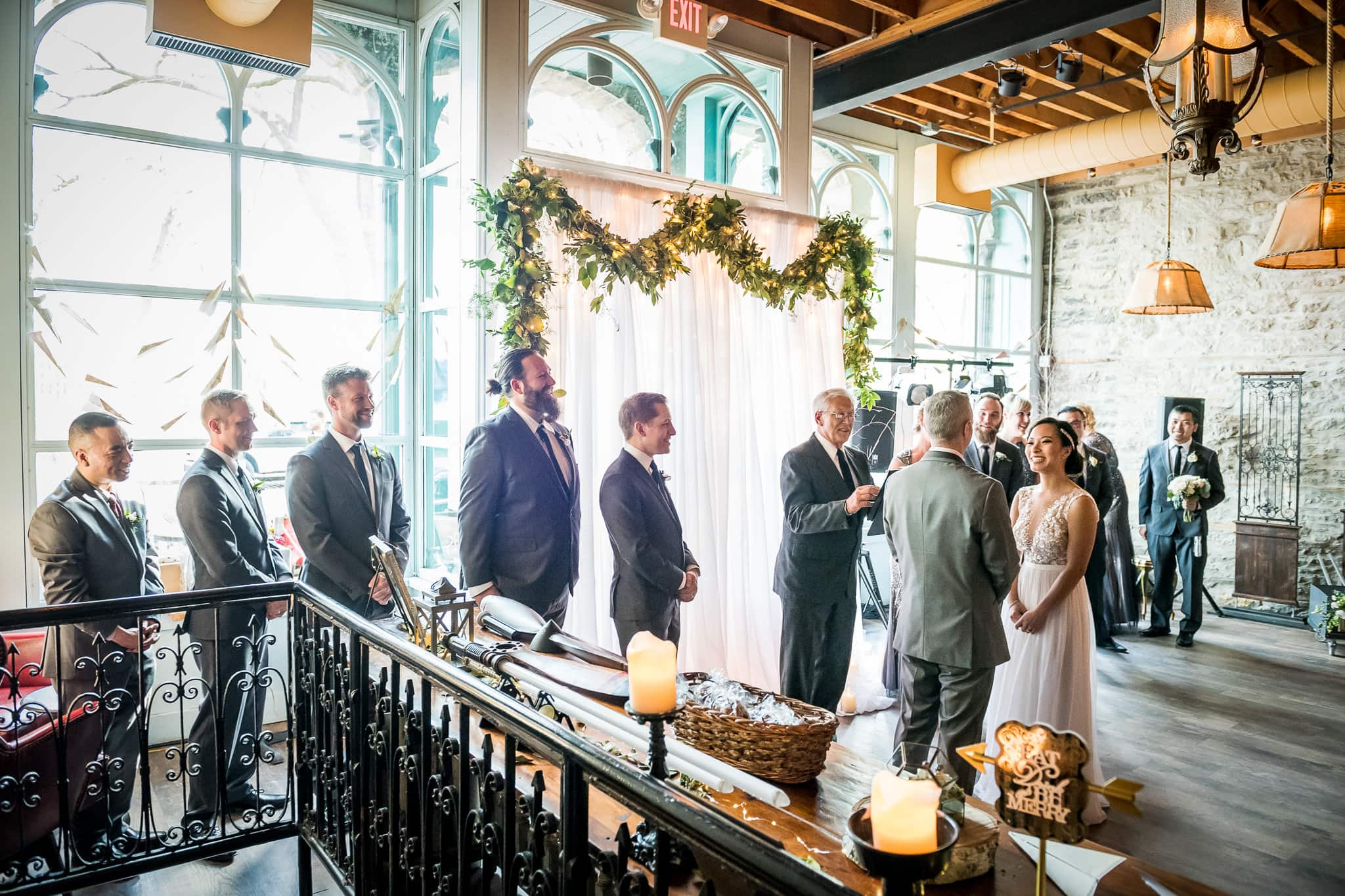 Bride and Groom exchange vows in the River Room at Aster Cafe 2