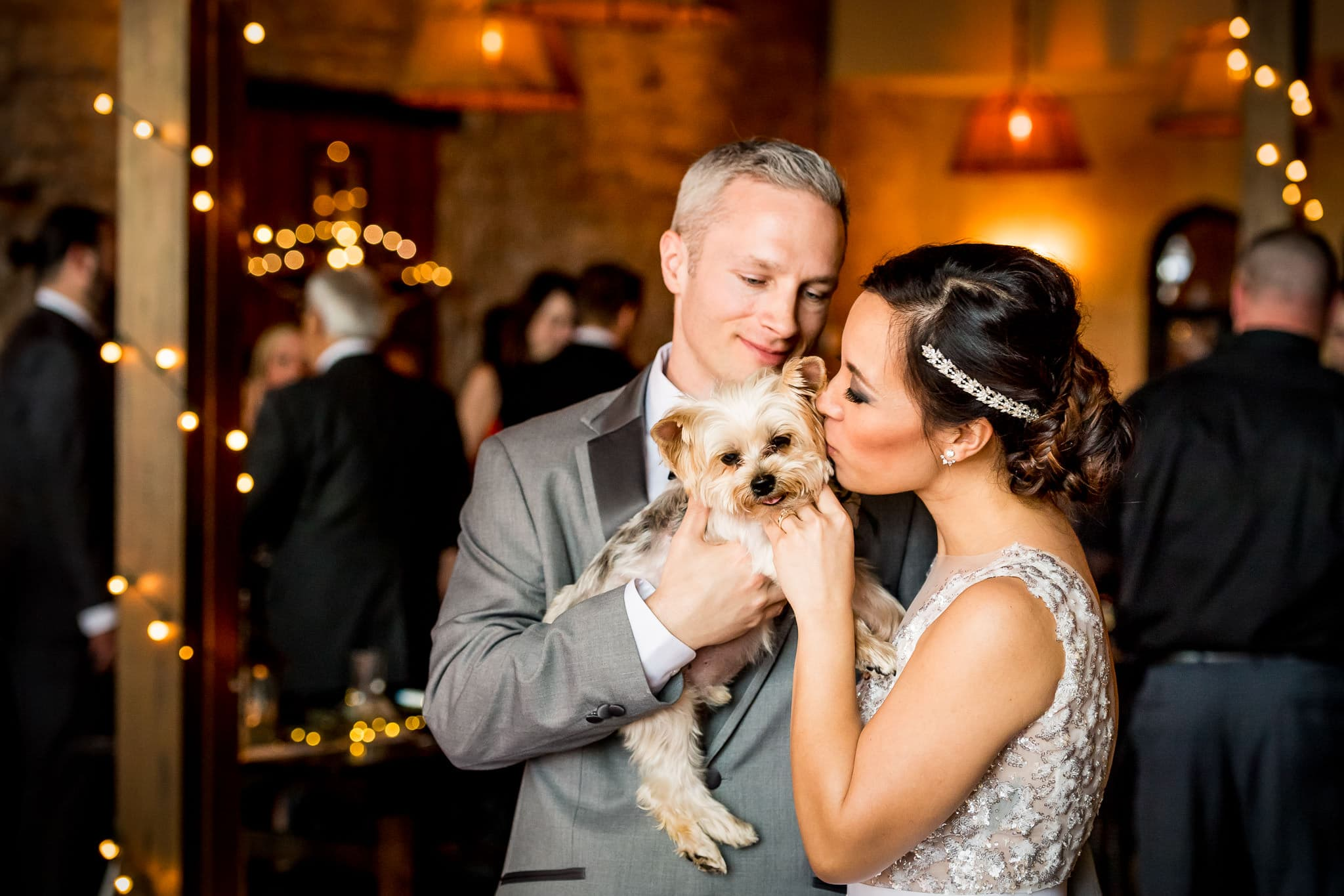 Bride and Groom with their dog during the wedding reception at Aster Cafe 2
