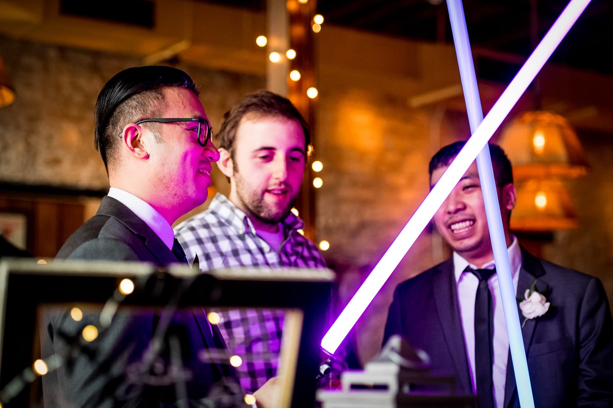 Star Wars Light Saber battle during the wedding reception in the River Room at Aster Cafe 5