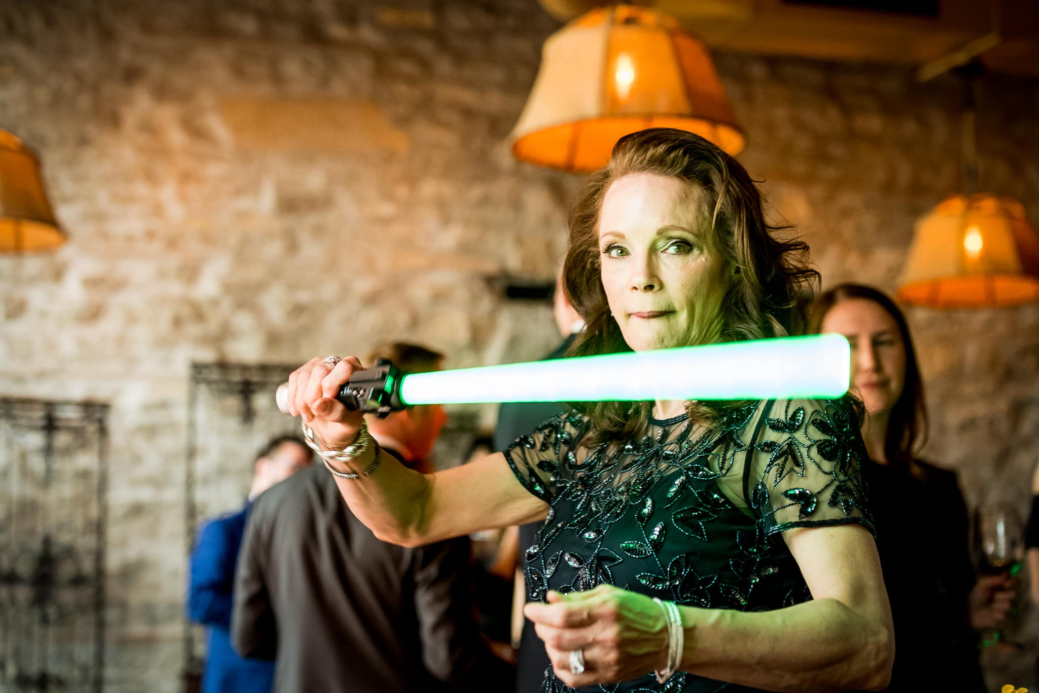 Star Wars Light Saber battle during the wedding reception in the River Room at Aster Cafe 4