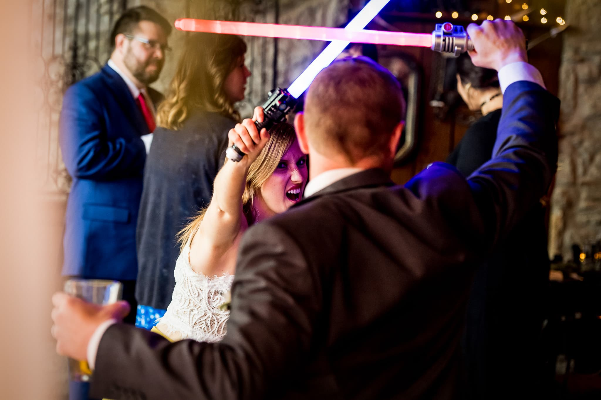 Star Wars Light Saber battle during the wedding reception in the River Room at Aster Cafe 2