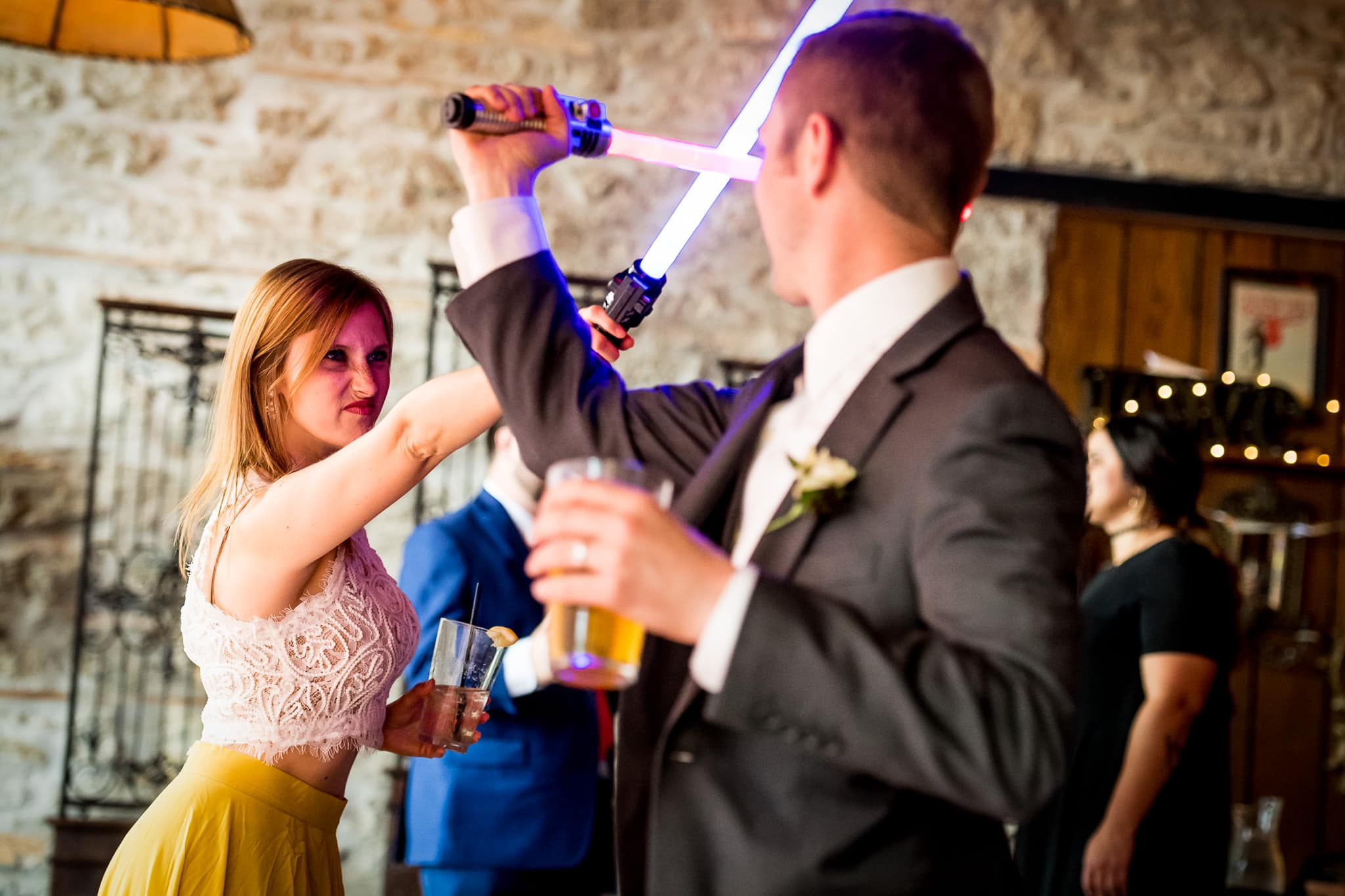 Star Wars Light Saber battle during the wedding reception in the River Room at Aster Cafe 1