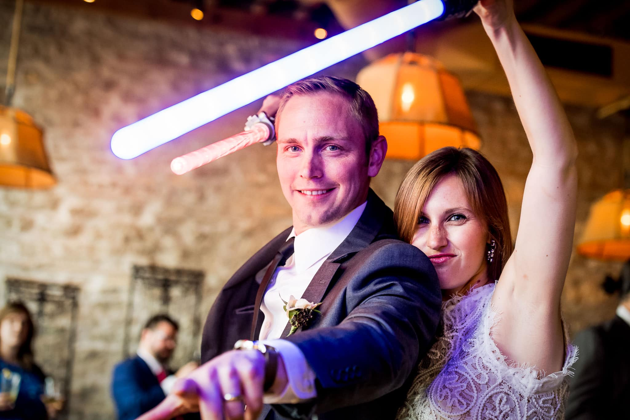 Star Wars Light Saber battle during the wedding reception in the River Room at Aster Cafe 3