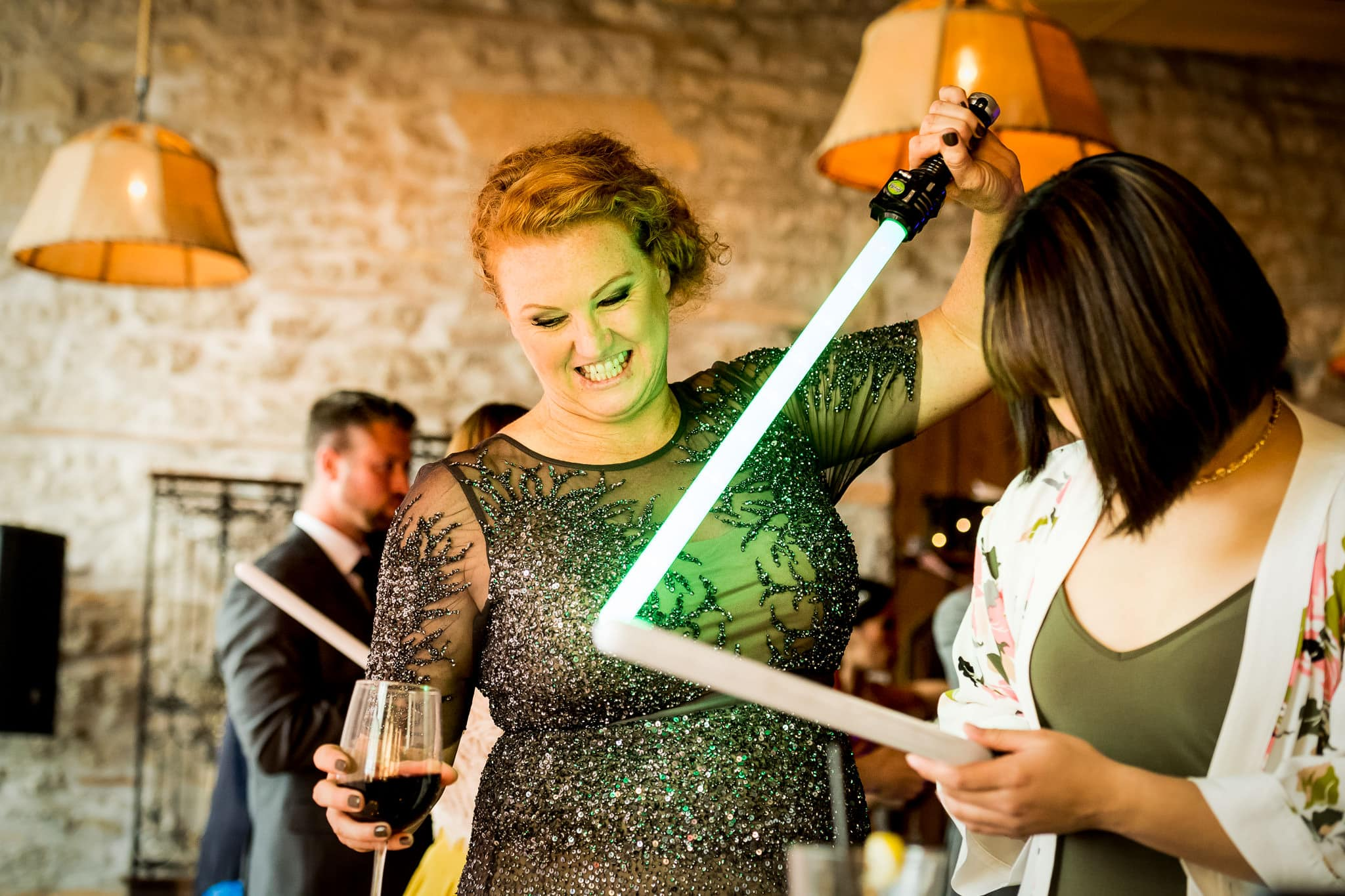 Star Wars Light Saber battle during the wedding reception in the River Room at Aster Cafe 6