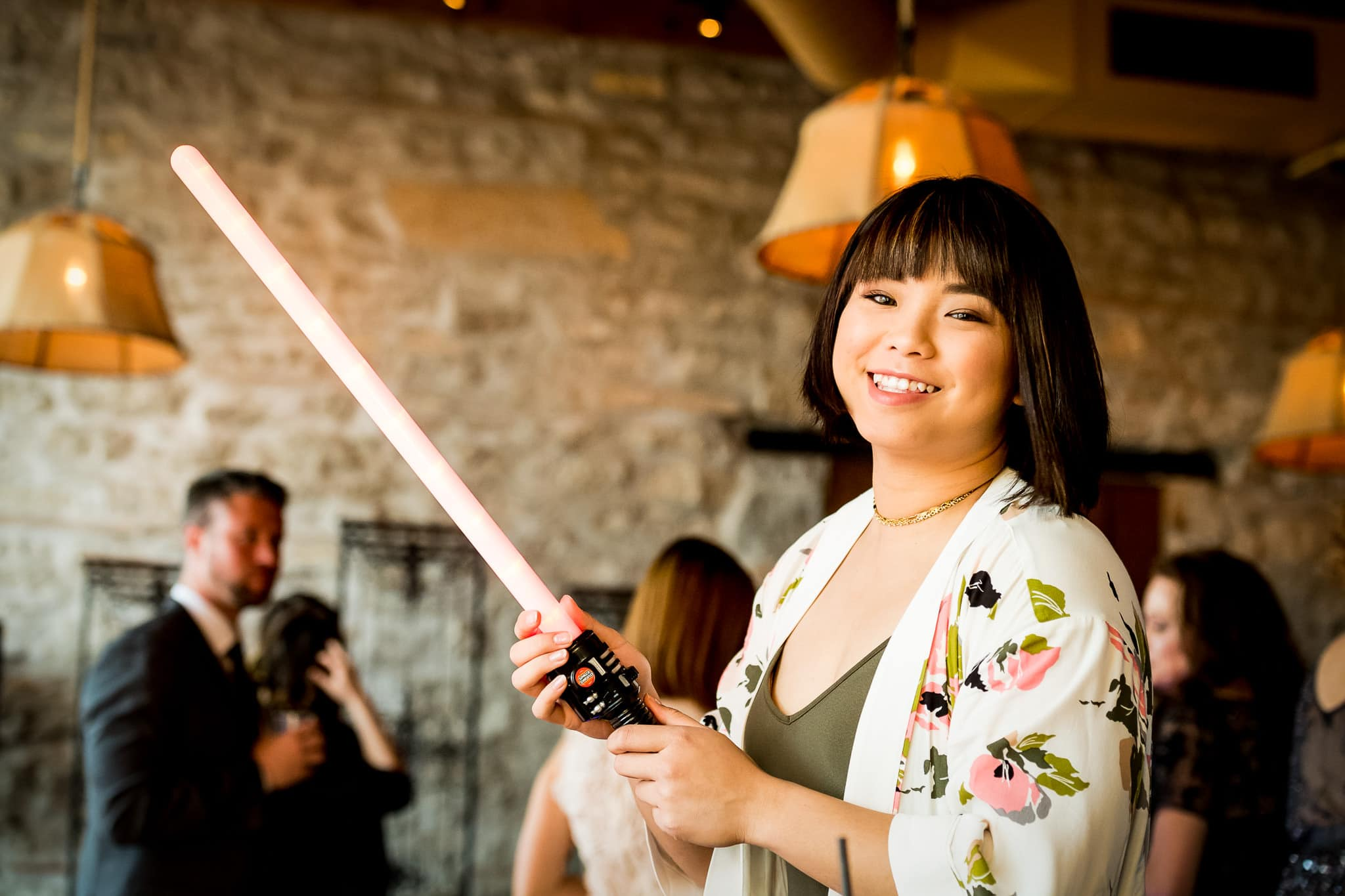 Star Wars Light Saber battle during the wedding reception in the River Room at Aster Cafe 7