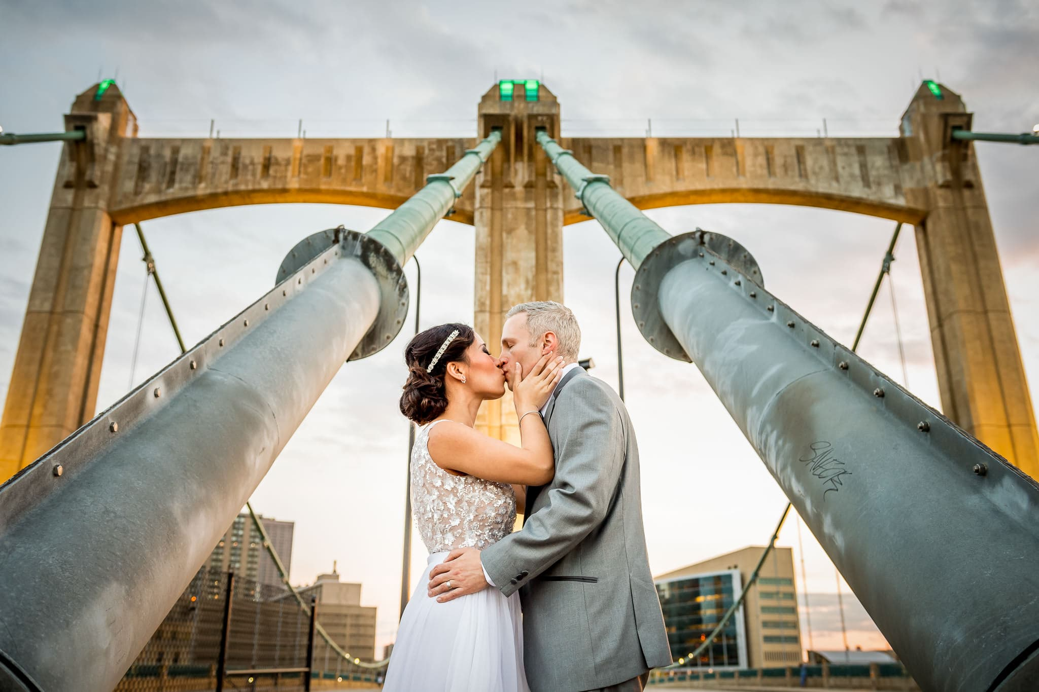Golden Hour kiss with the Bride and Groom on the Hennepin Avenue Bridge in Minneapolis