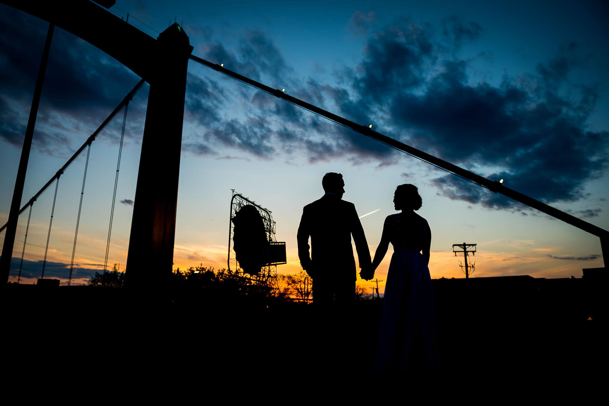 Bride and Groom Sunset Silhouette from the Hennepin Avenue Bridge with the Grain Belt Premium sign in the background