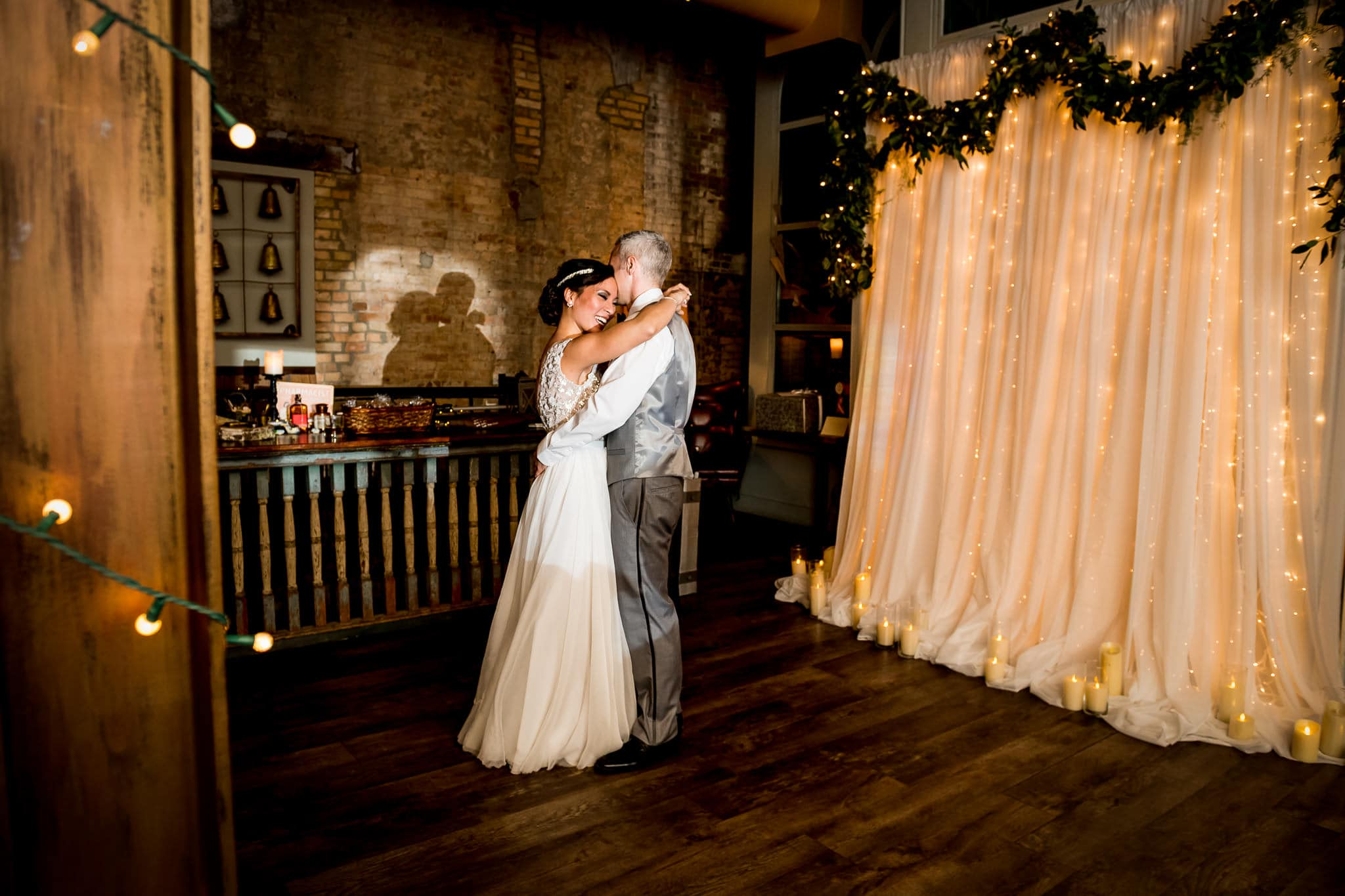 Bride and Groom sharing their First Dance in the River Room at Aster Cafe