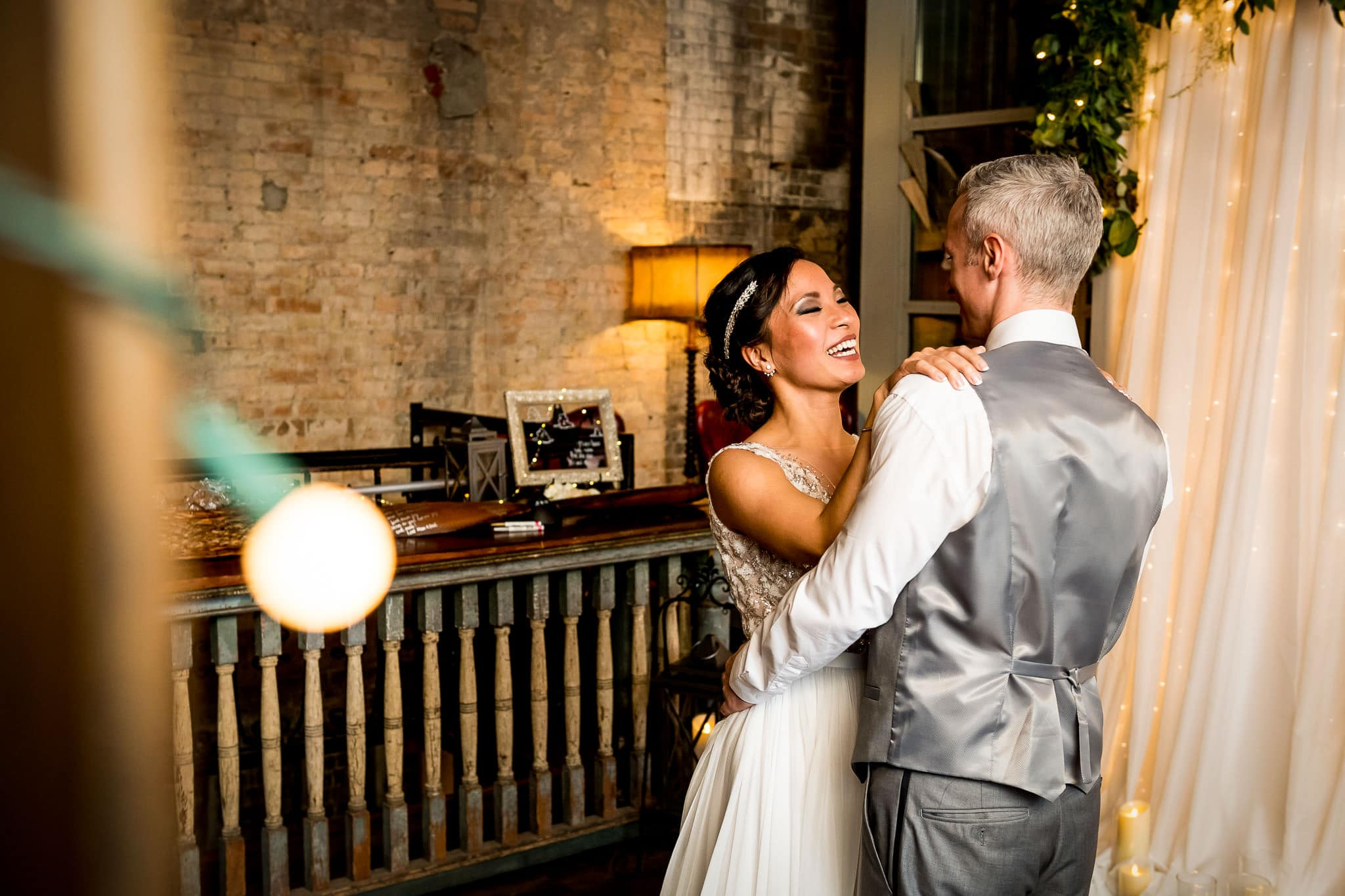 Bride and Groom sharing their First Dance in the River Room at Aster Cafe 2