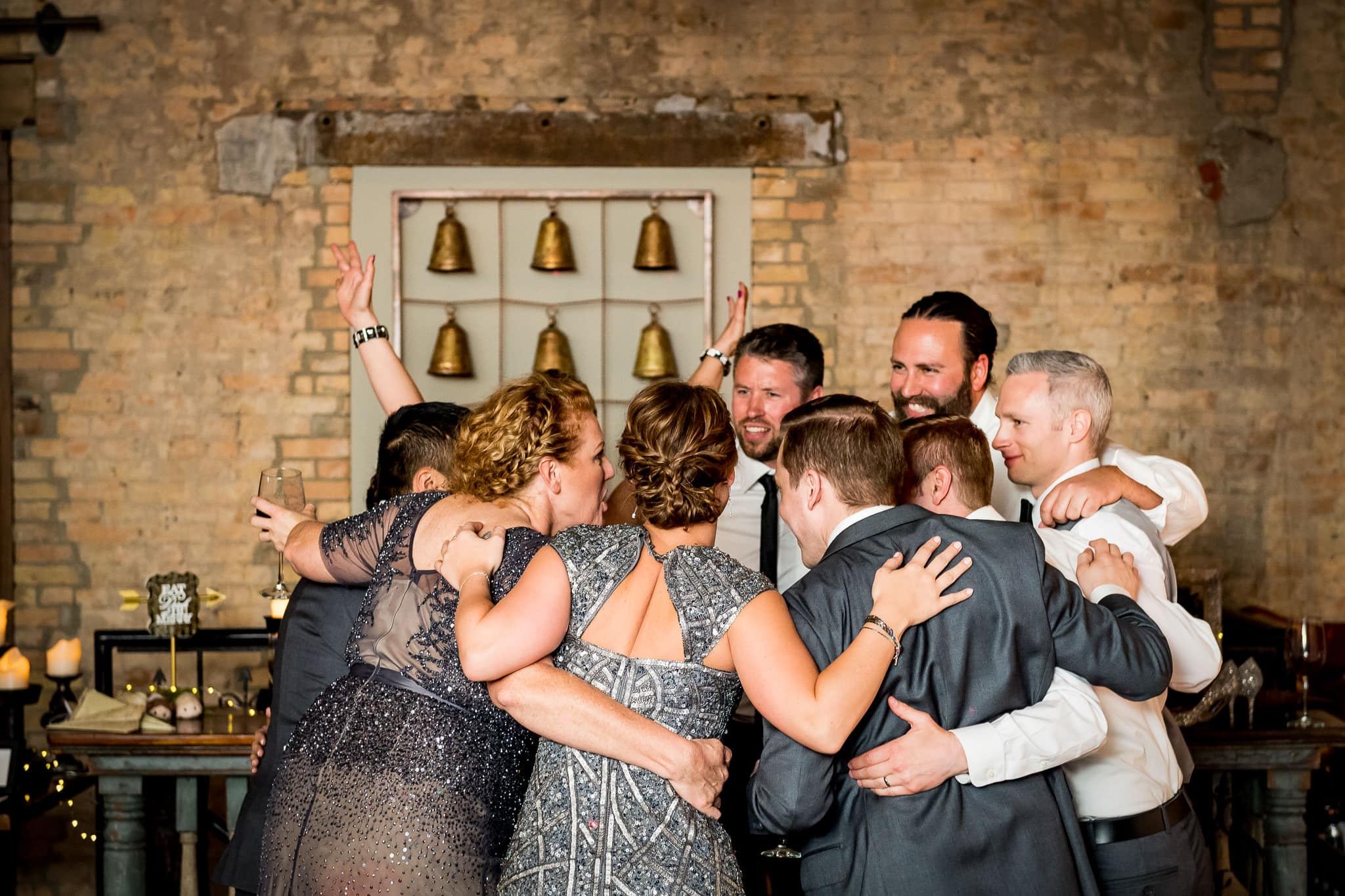 Wedding party sharing a fun moment on the dance floor in the River Room at Aster Cafe during the wedding reception 2