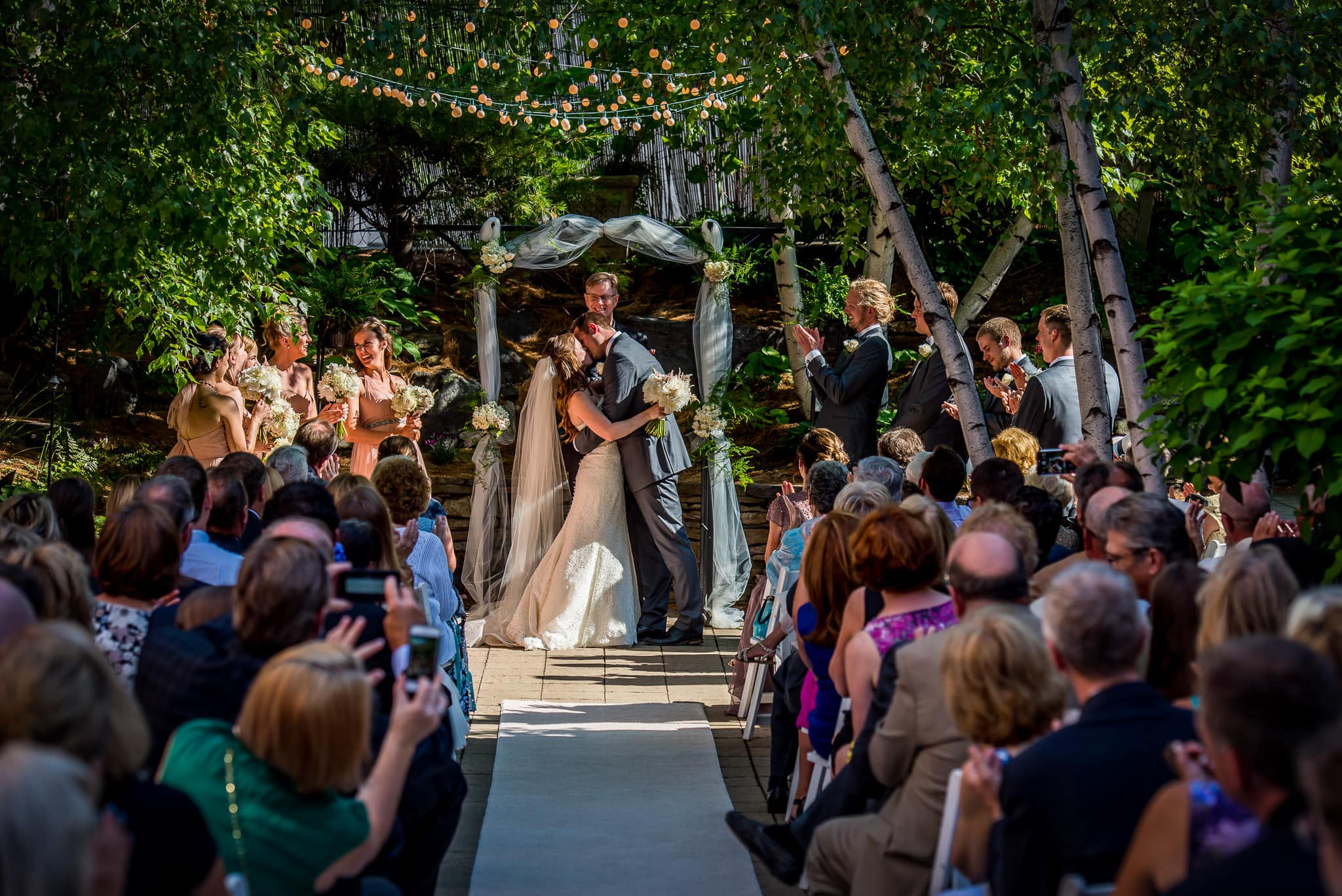 Bride & Groom share their first kiss during their wedding ceremony at the Van Dusen Mansion