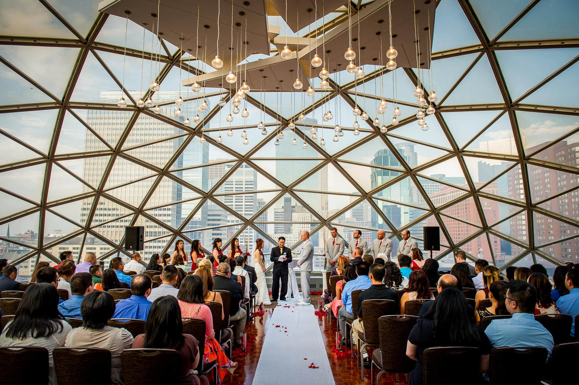 Millenium hotel wedding ceremony in the dome with downtown Minneapolis in the background
