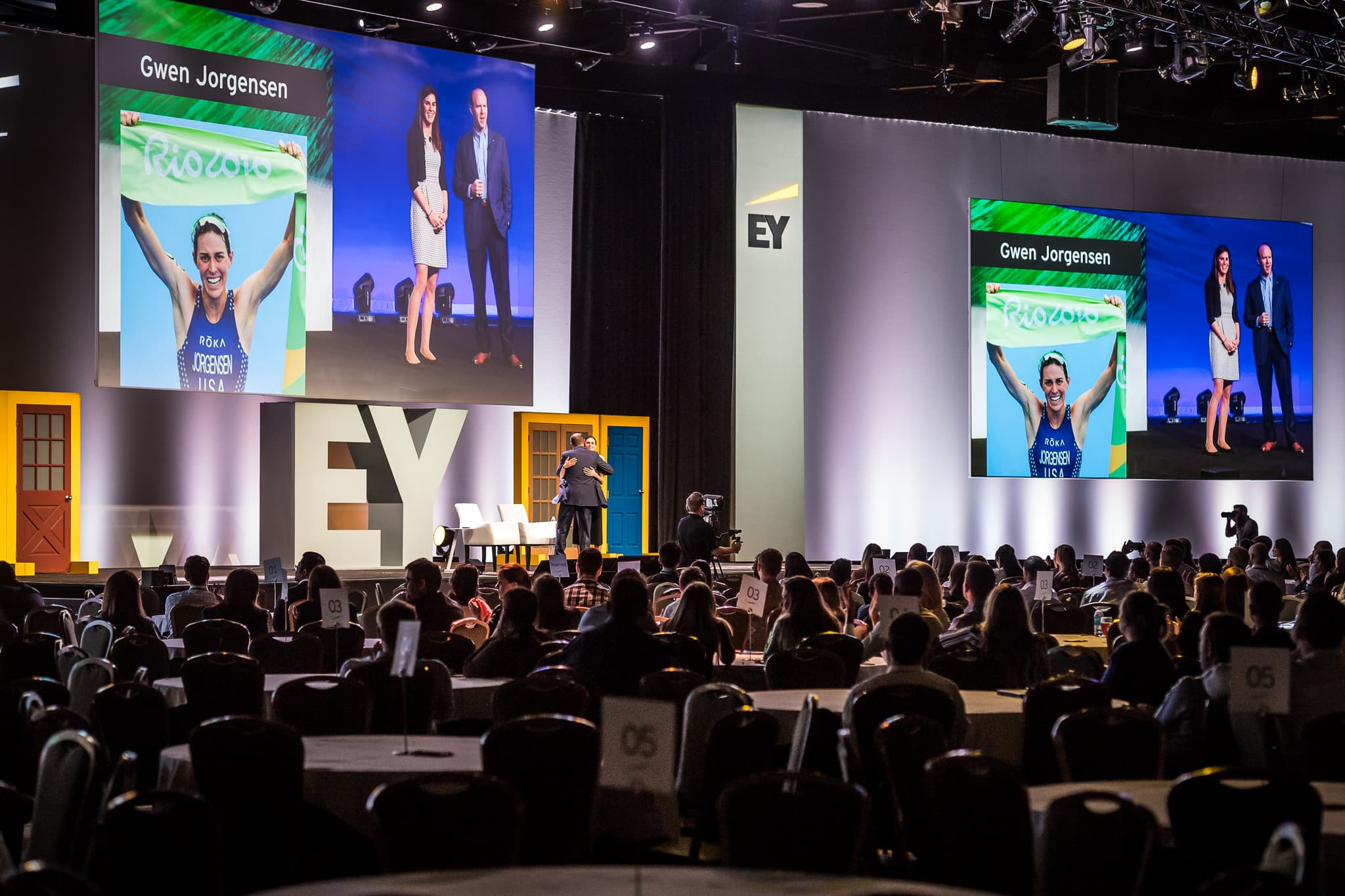 Gwen Jorgensen is greeted on stage for her talk with EY executive at their annual corporate event