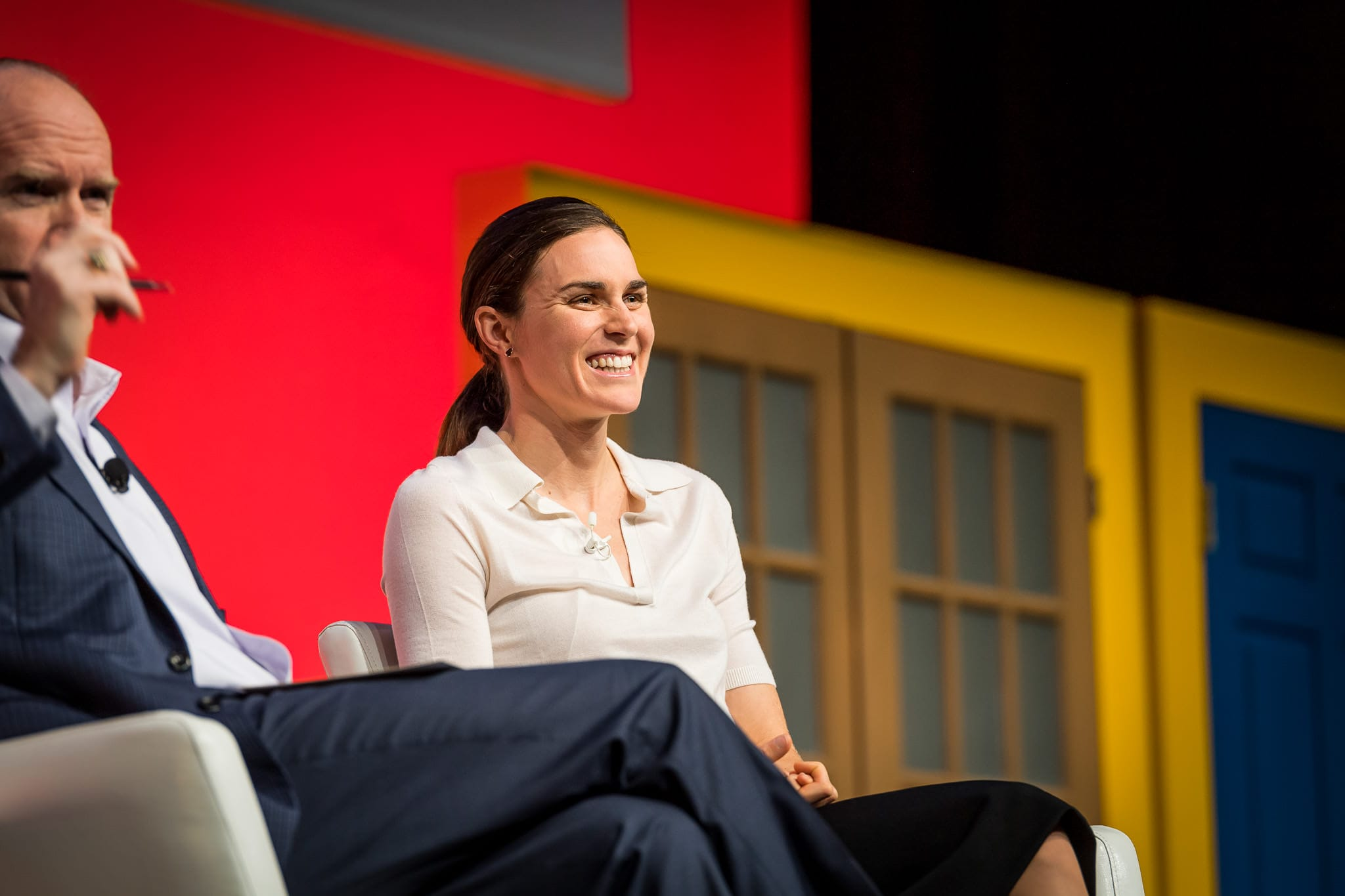Olympic gold medal winner Gwen Jorgensen laughs during her talk at the EY Milestones corporate event in Orlando, FL