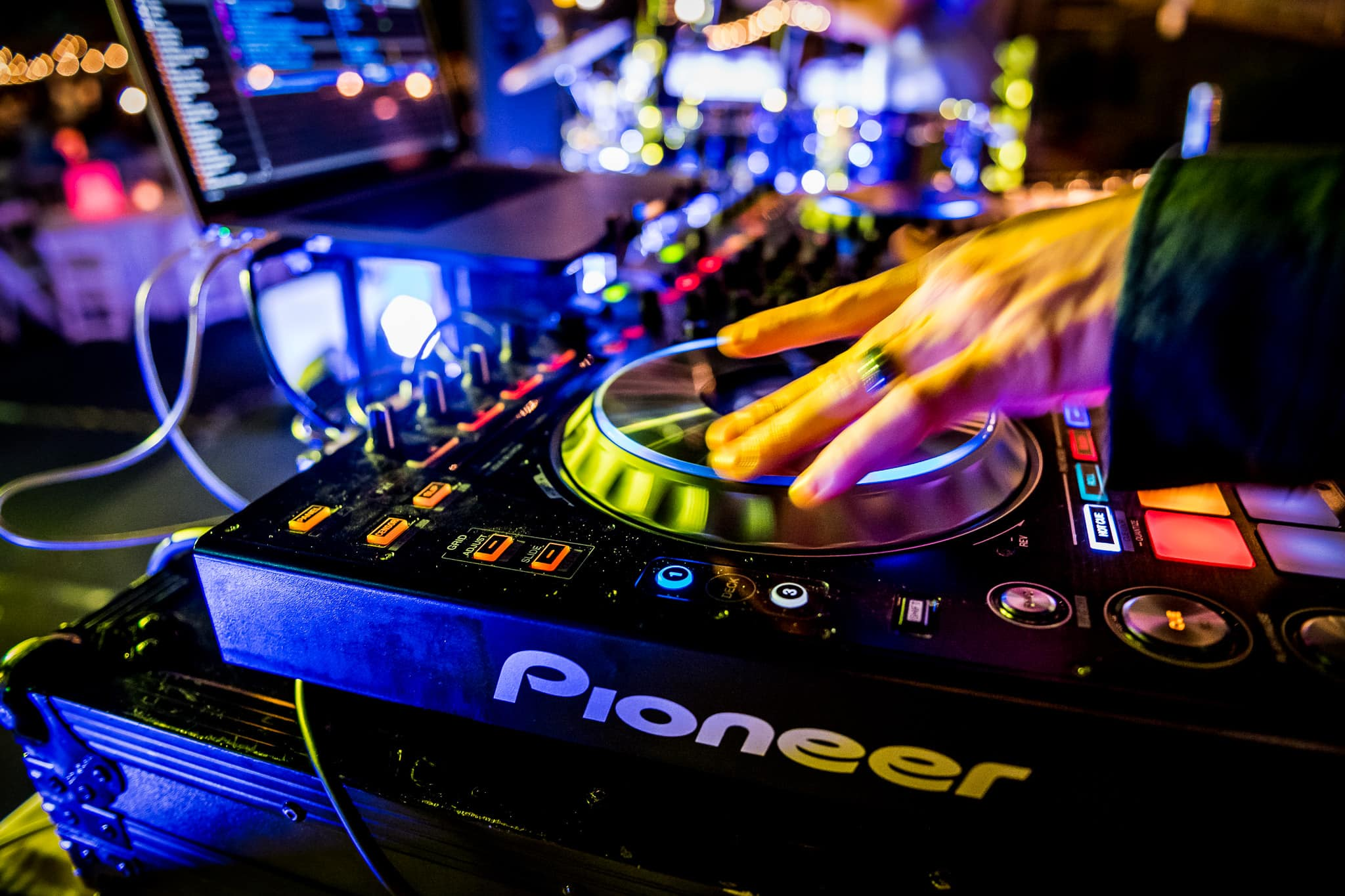Close up of the DJ's hands on the turntables at the Food Truck party during an annual EY corporate event
