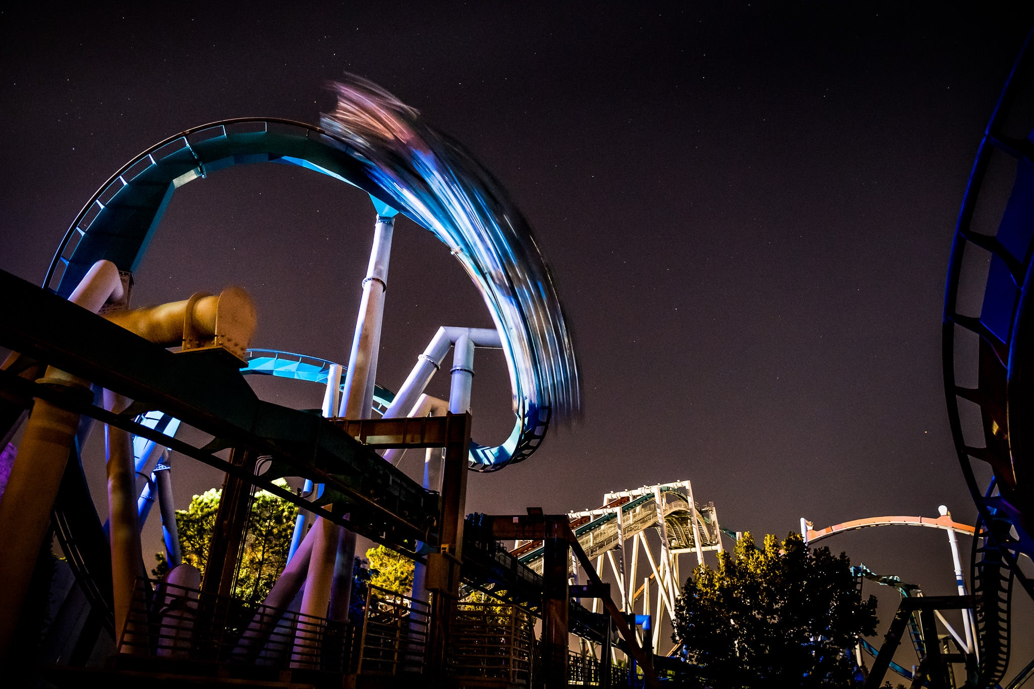 Long exposure photo of corporate event employees riding a rollercoaster