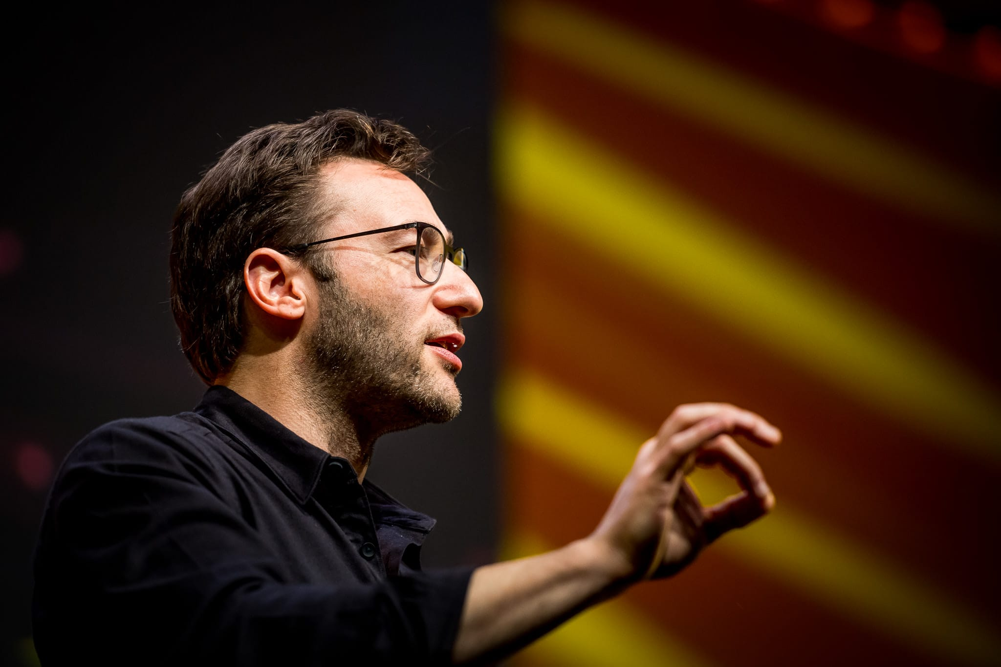 Simon Sinek Photo speaking at a Corporate Event
