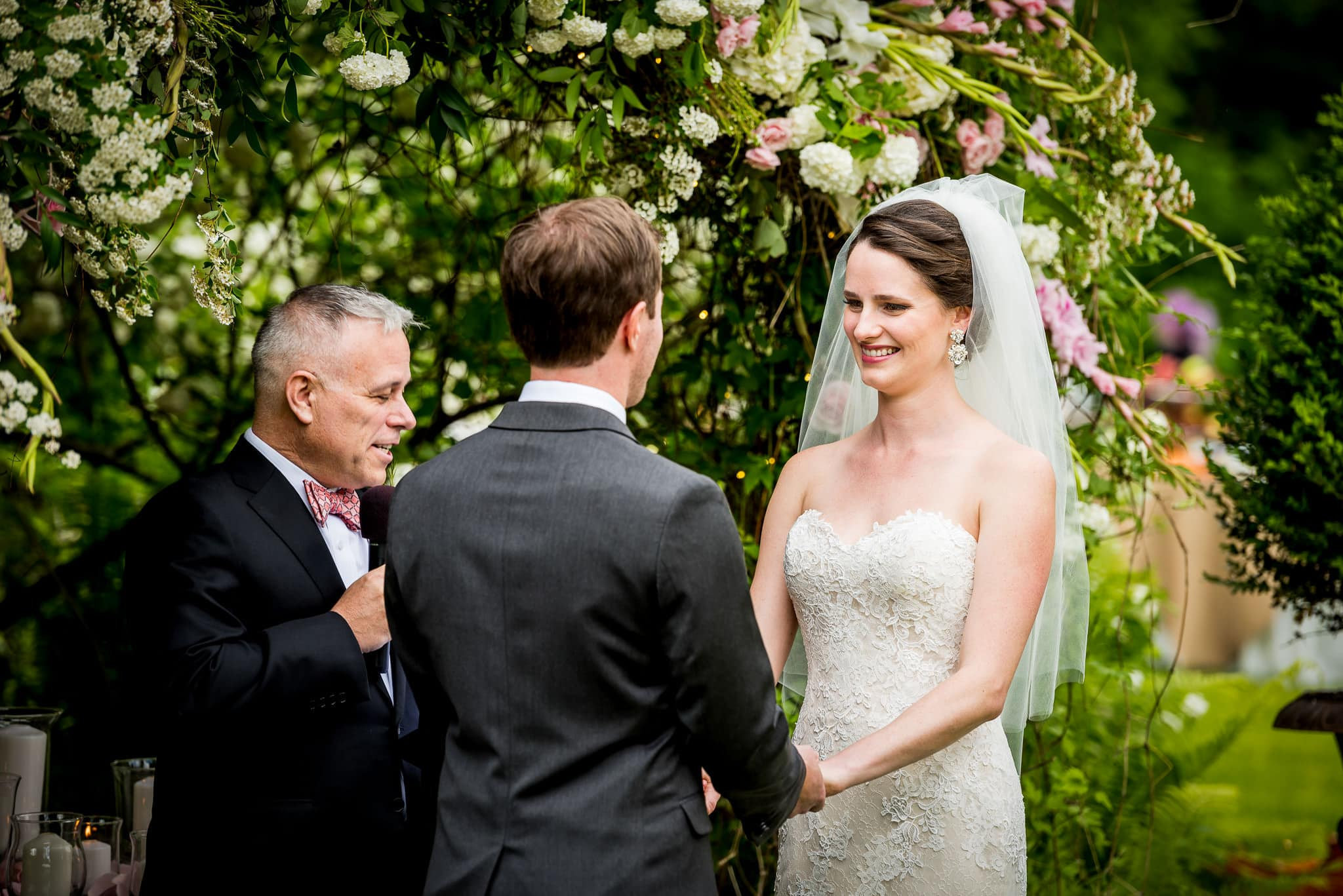 Camrose Hill Flower Farm flower alter with Bride and Groom smiling at each other