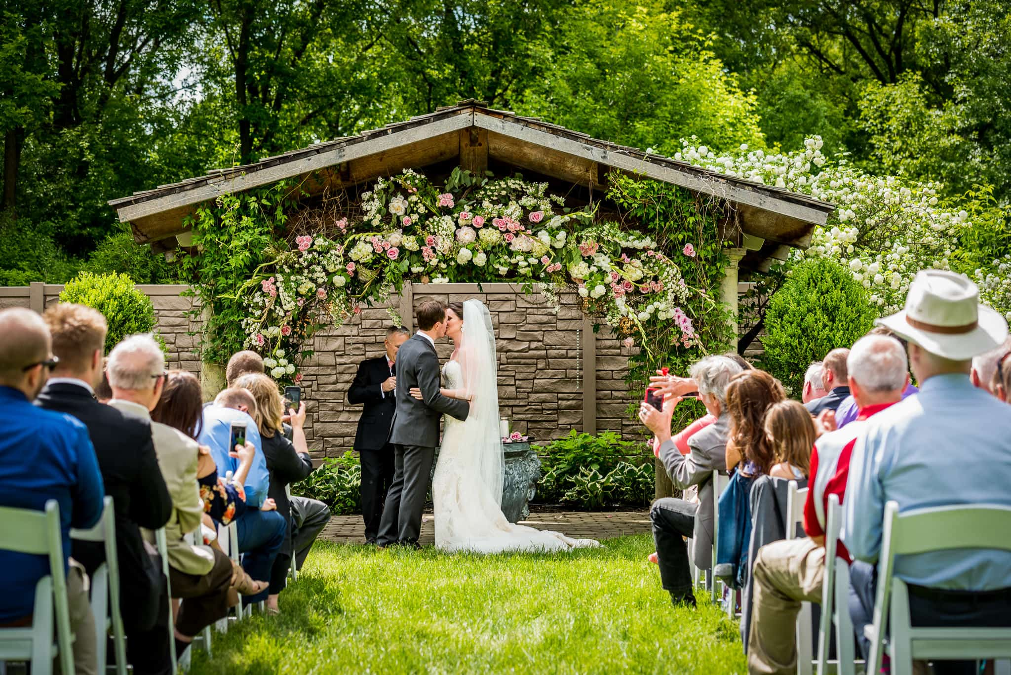 The first kiss at a Camrose Hill Flower Farm wedding