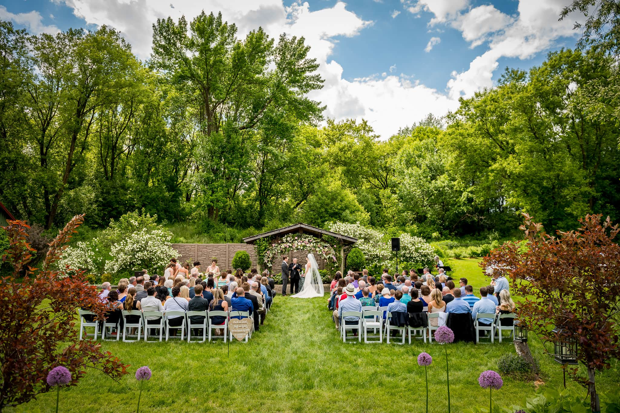 Wide angle of wedding ceremony at Camrose Hill Flower Farm