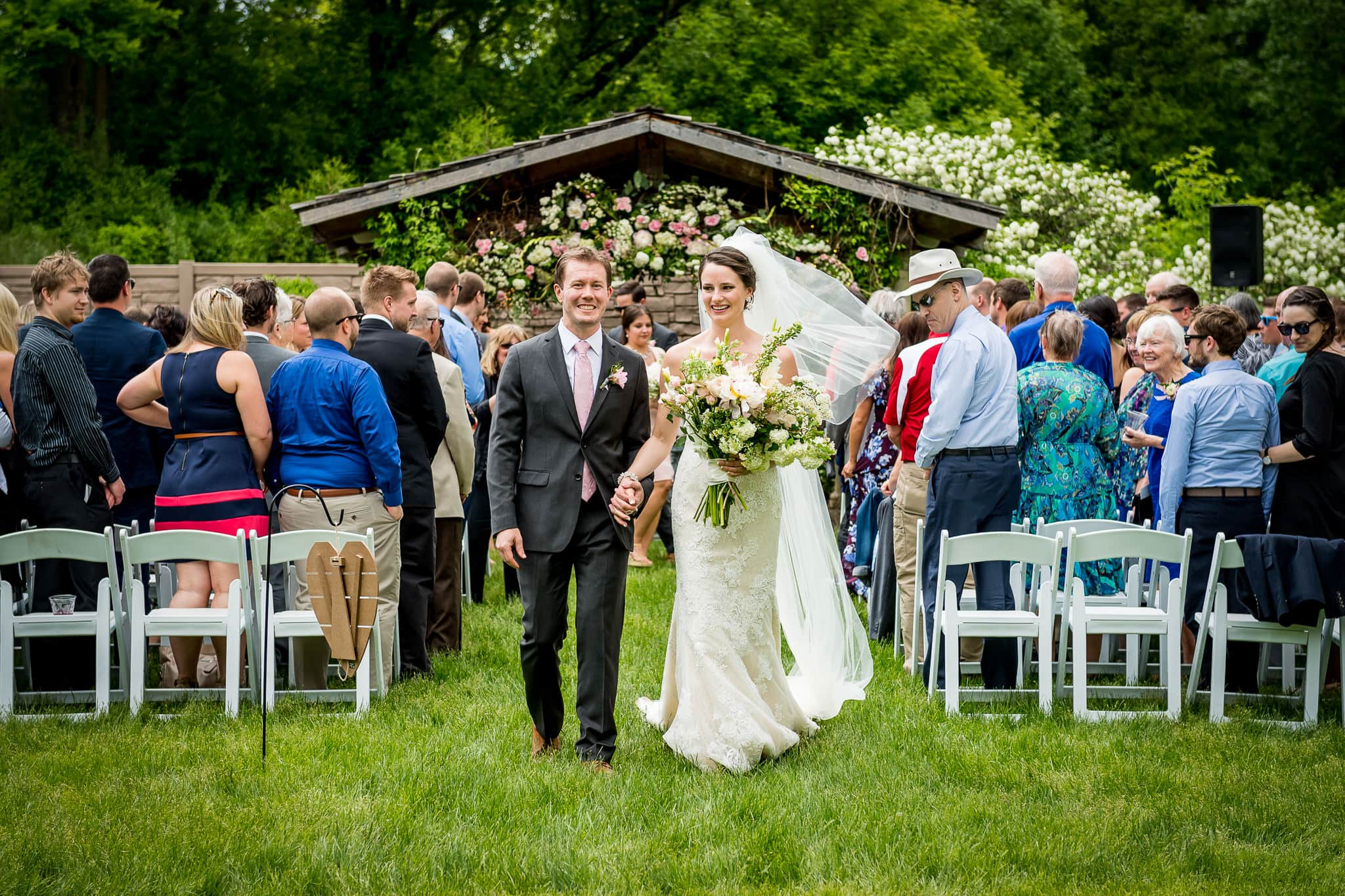Bride and Groom walking back up the isle as husband and wife at Camrose Hill Flower Farm