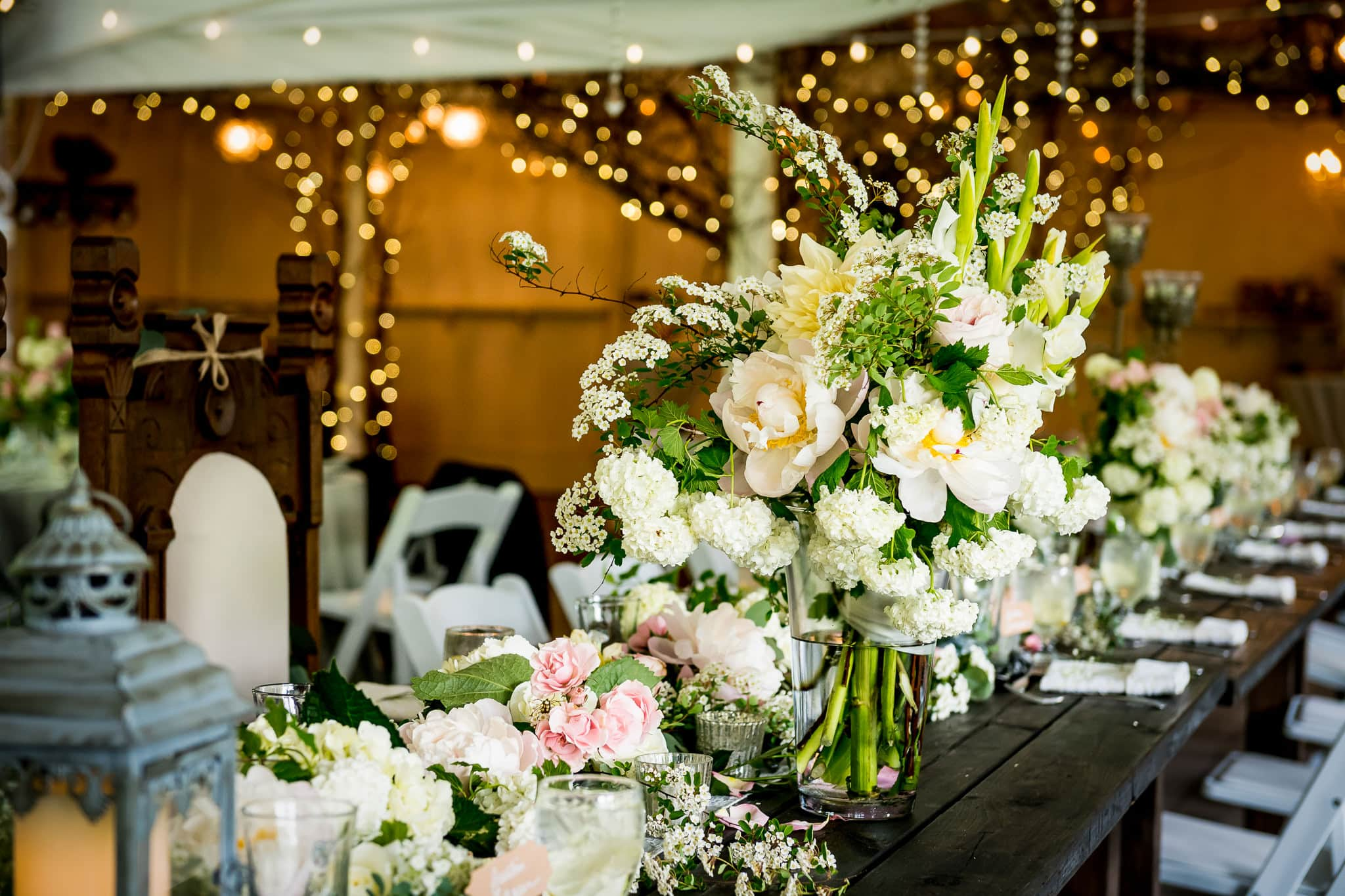 Beautiful floral arrangements on the wedding reception tables at Camrose Hill Flower Farm