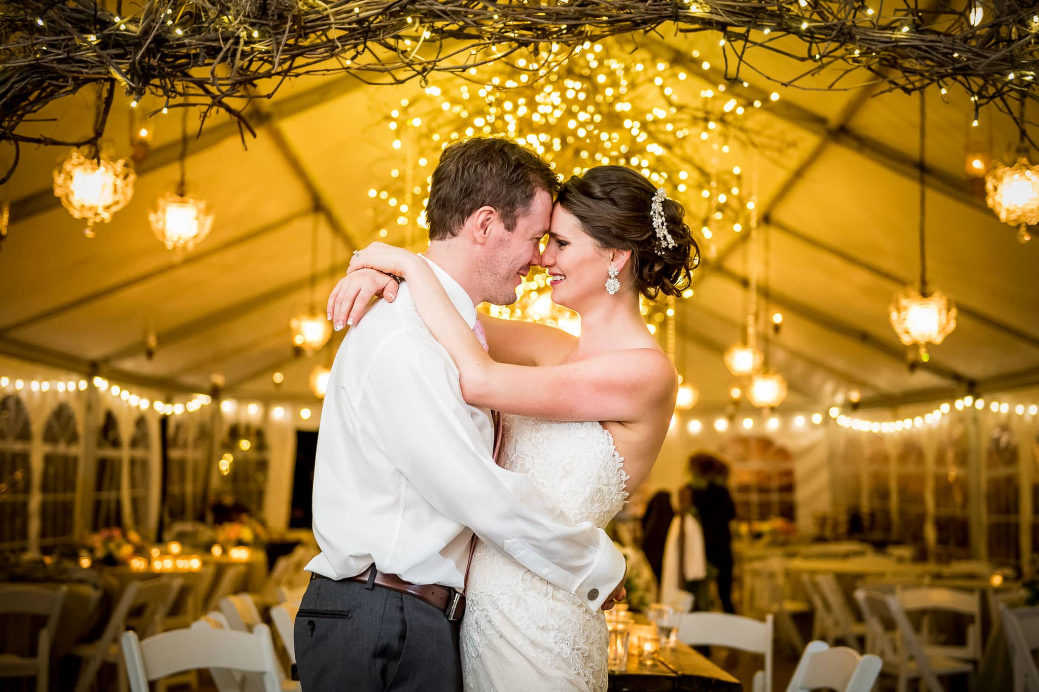 Bride and groom with a backdrop of gorgeous wedding reception lights at Camrose Hill Flower Farm