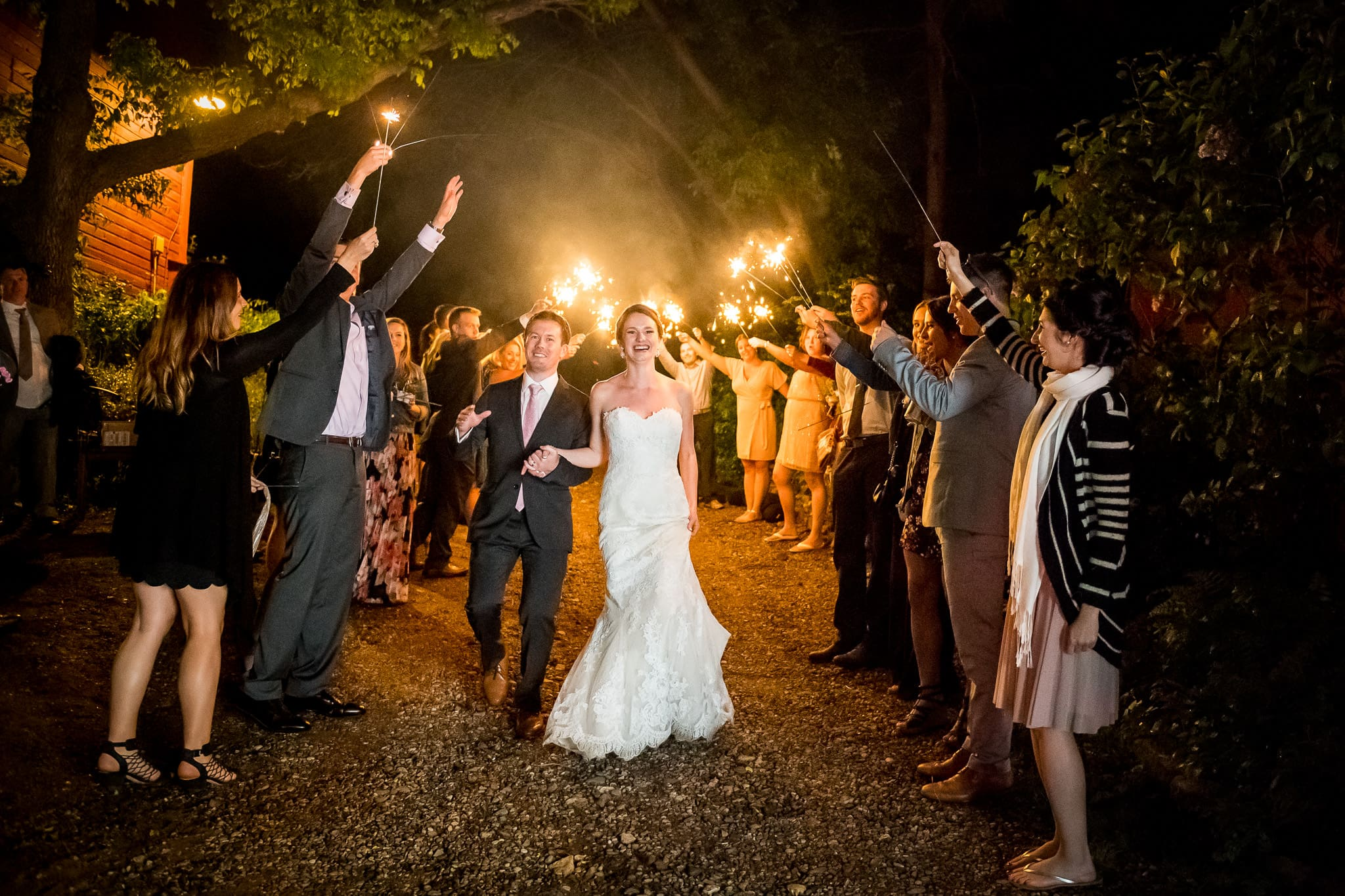 Bride and groom sparkler send off at the end of the wedding day at Camrose Hill Flower Farm