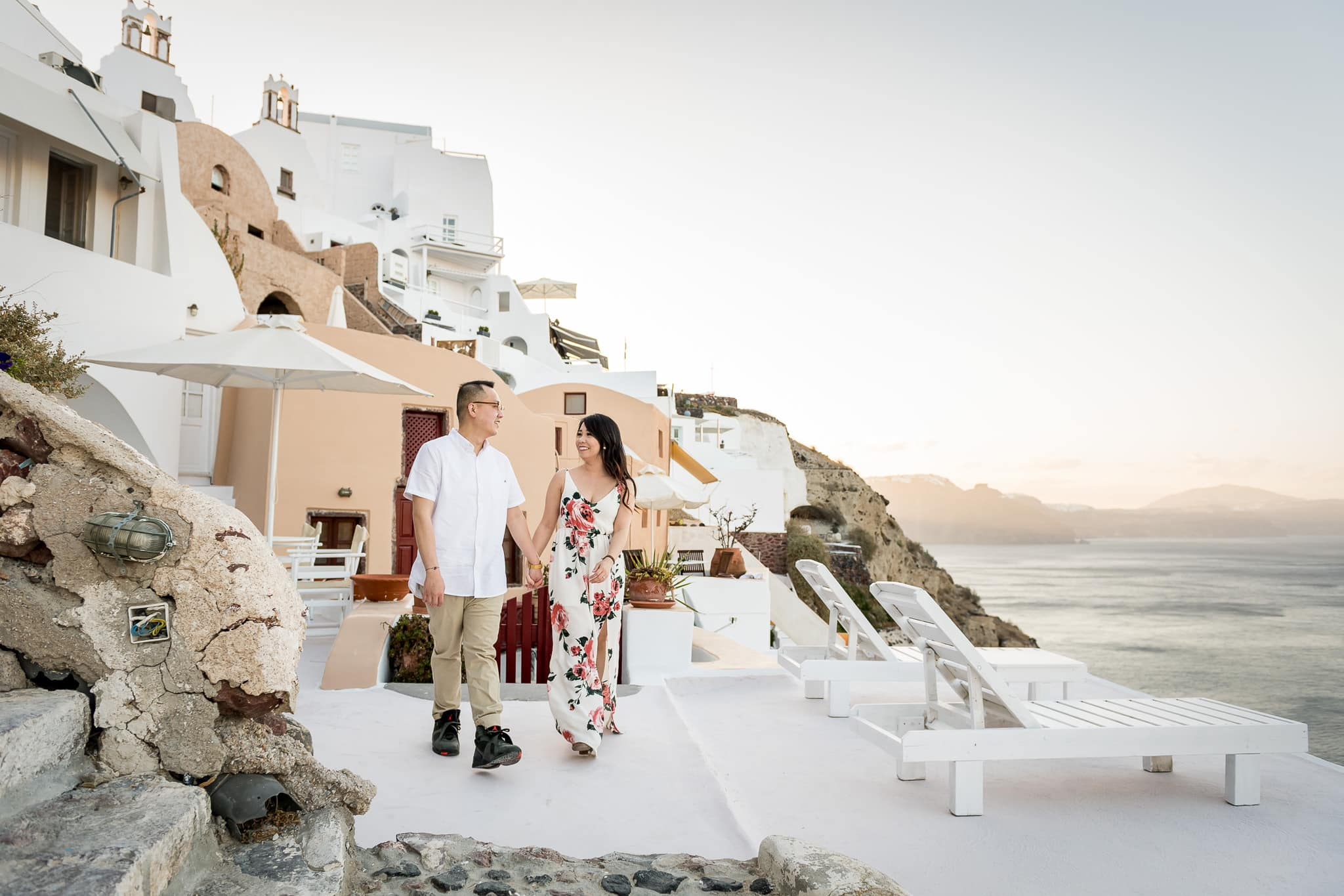 Couple walking and holding hands in Santorini, Greece