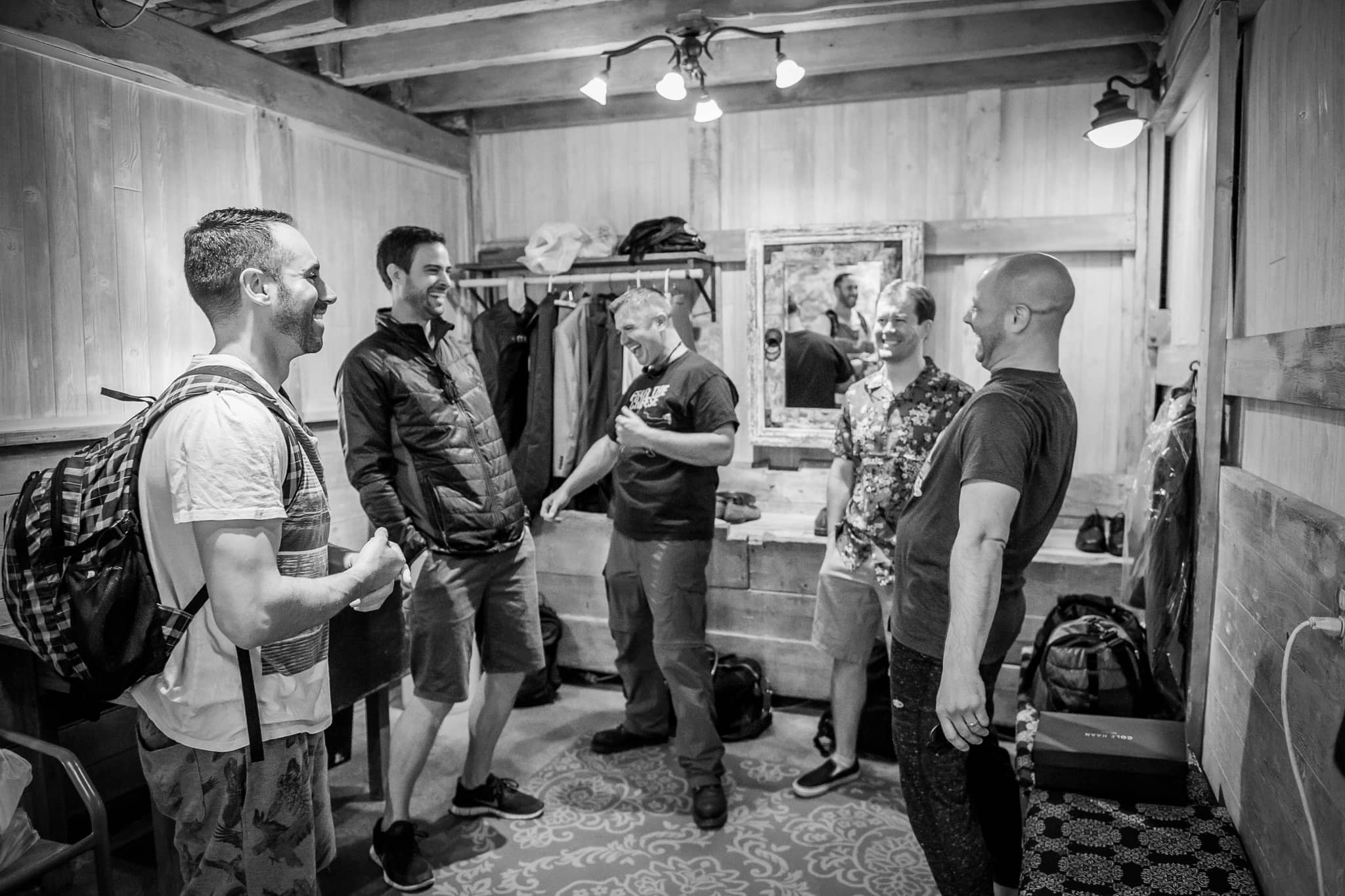Groomsmen laughing it up while getting ready at Camrose Hill Flower Farm