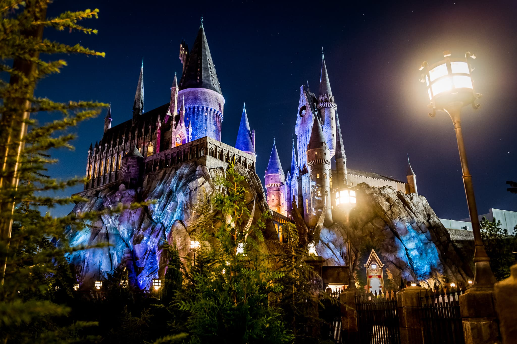 Hogwarts Castle at night during an EY corporate event at The Wizarding World of Harry Potter: Hogsmeade