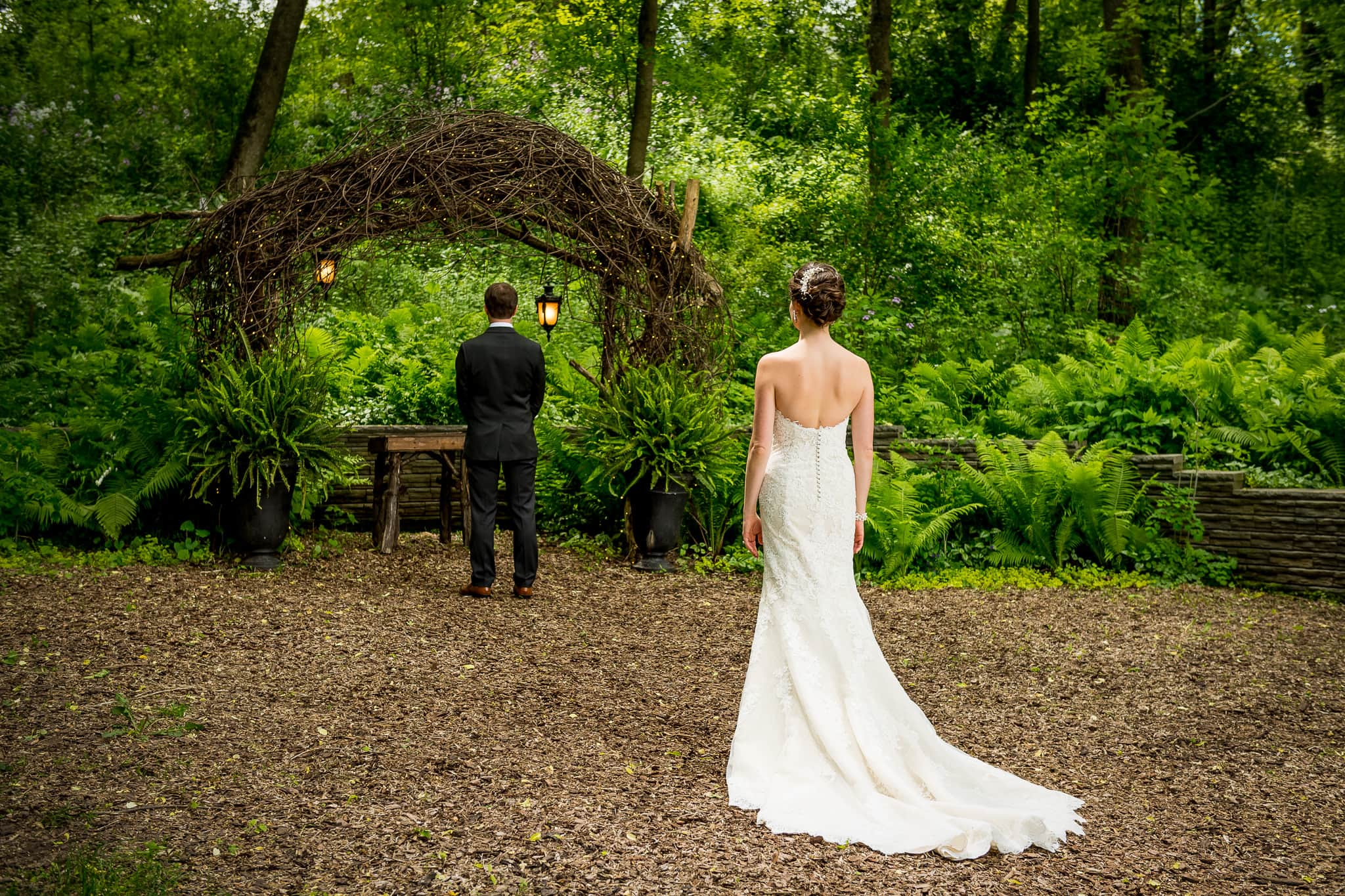 Bride & Groom are about to see each other for the first time in Camrose Hill Flower Farm's Fairy Glen outdoor area