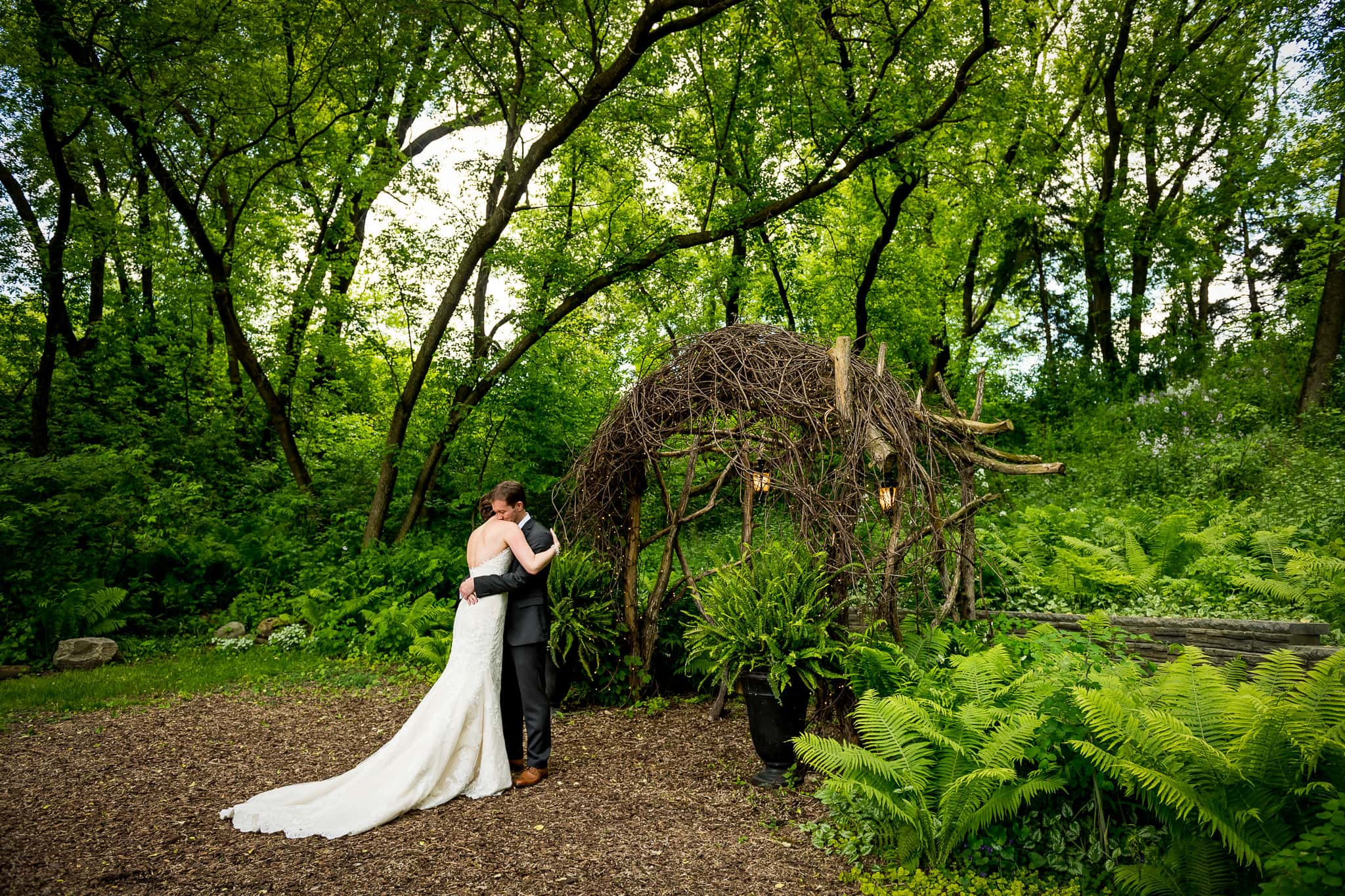 Bride & Groom deeply embrace in Camrose Hill Flower Farm's Fairy Glen