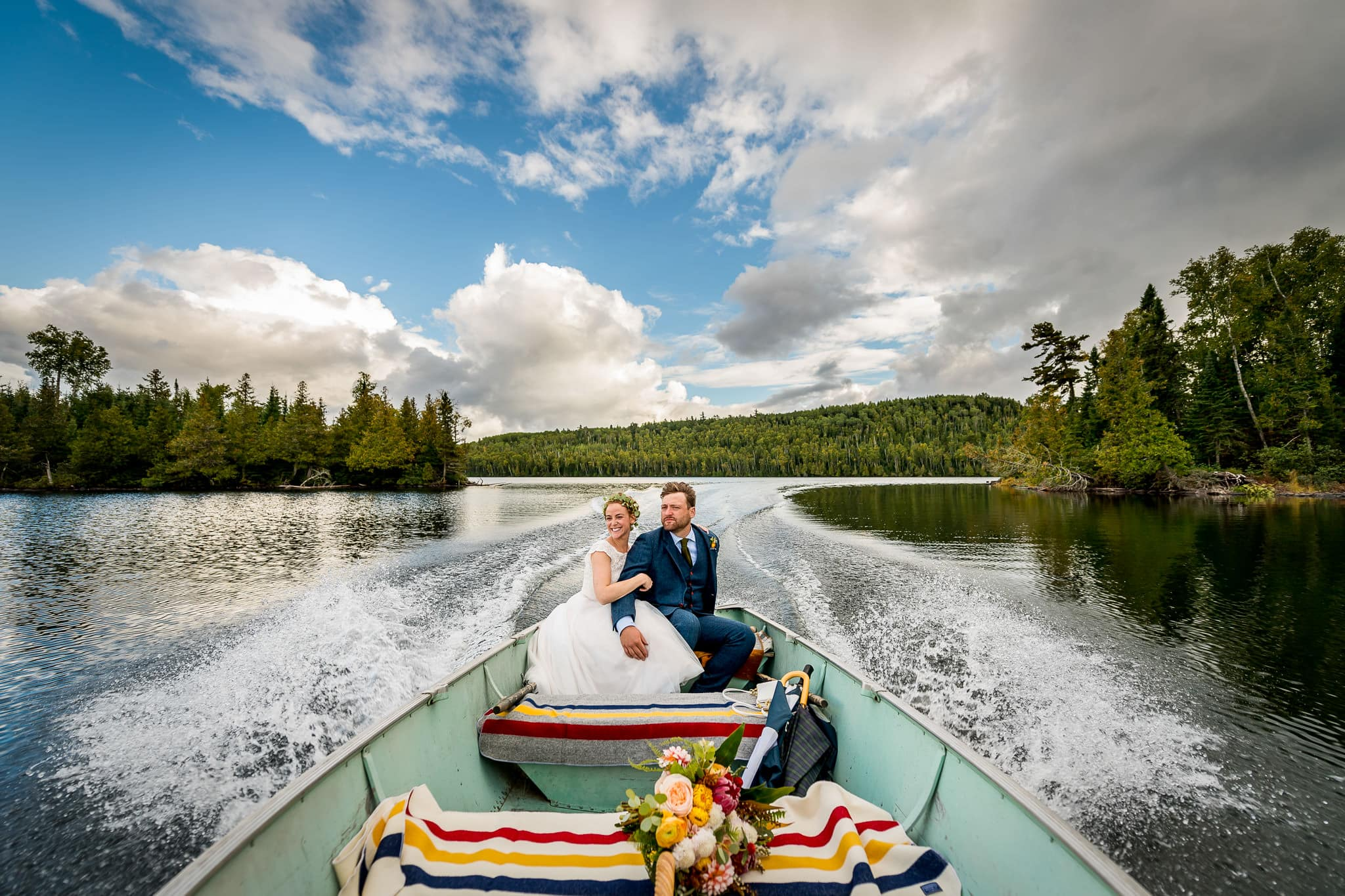 Bride and Groom driving boat on Hungry Jack Lake