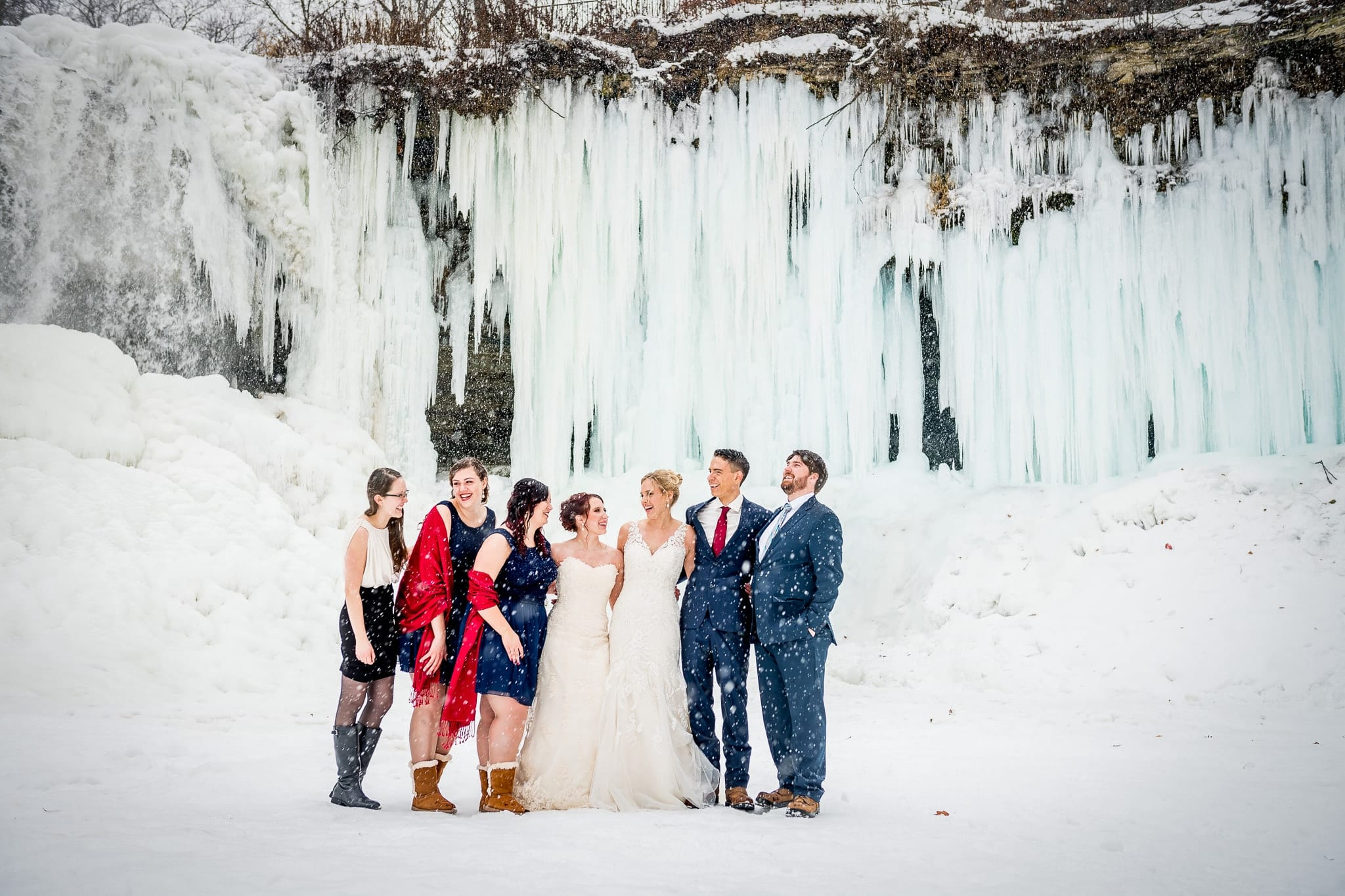 Bridal party in a winter snowfall at Minnehaha Falls on Minneapolis