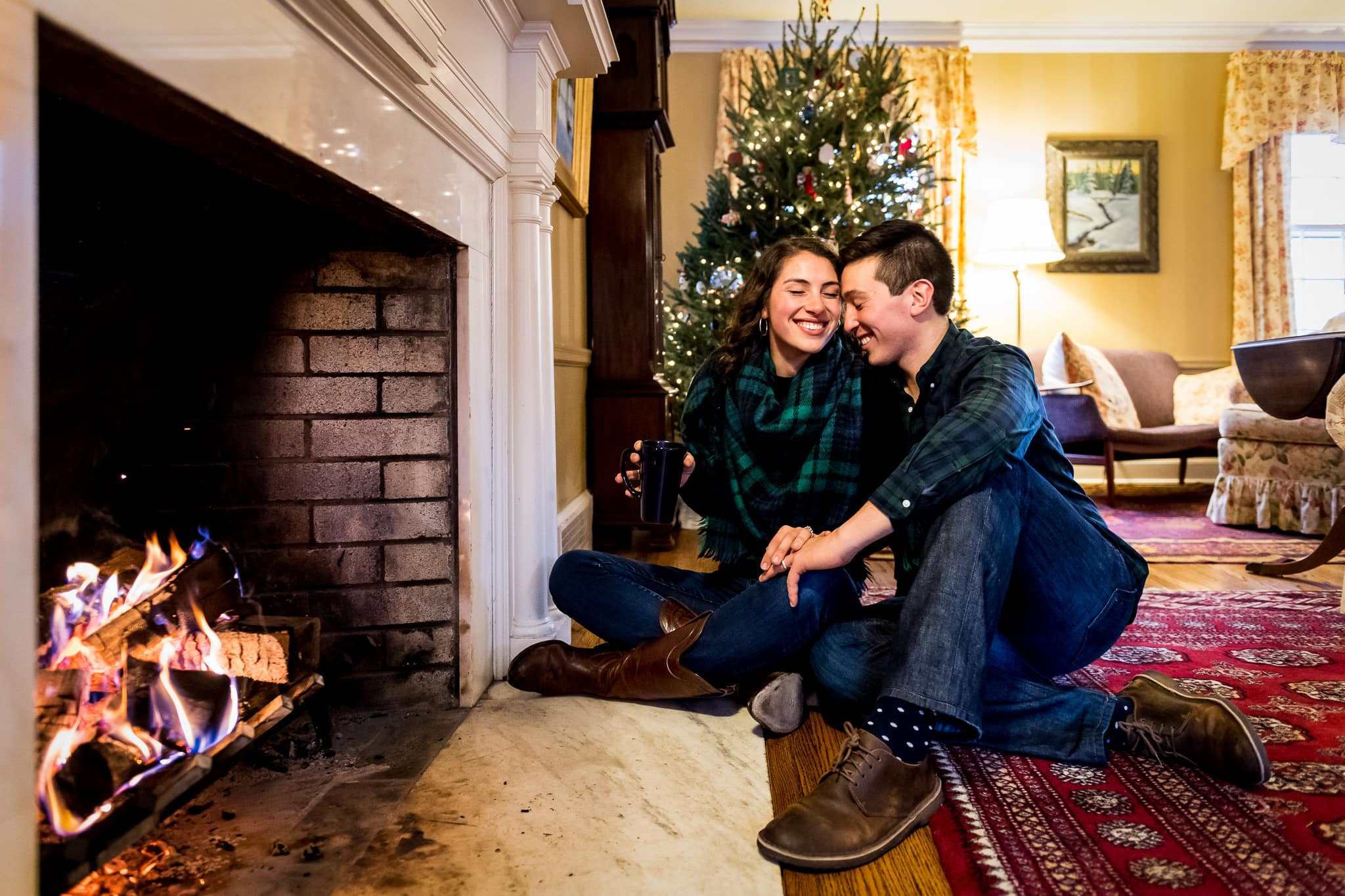Engagement photo inside by the fireplace in the Knollwood neighborhood in Hopkins, MN