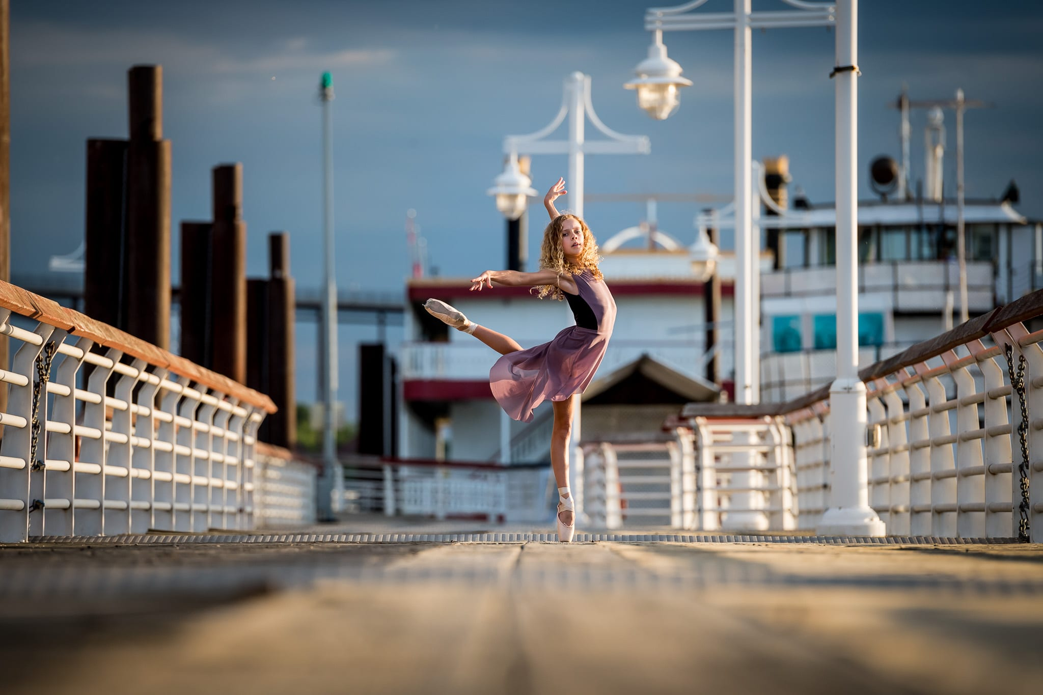 A young ballerina dancing on the boat docks at Harriet Island