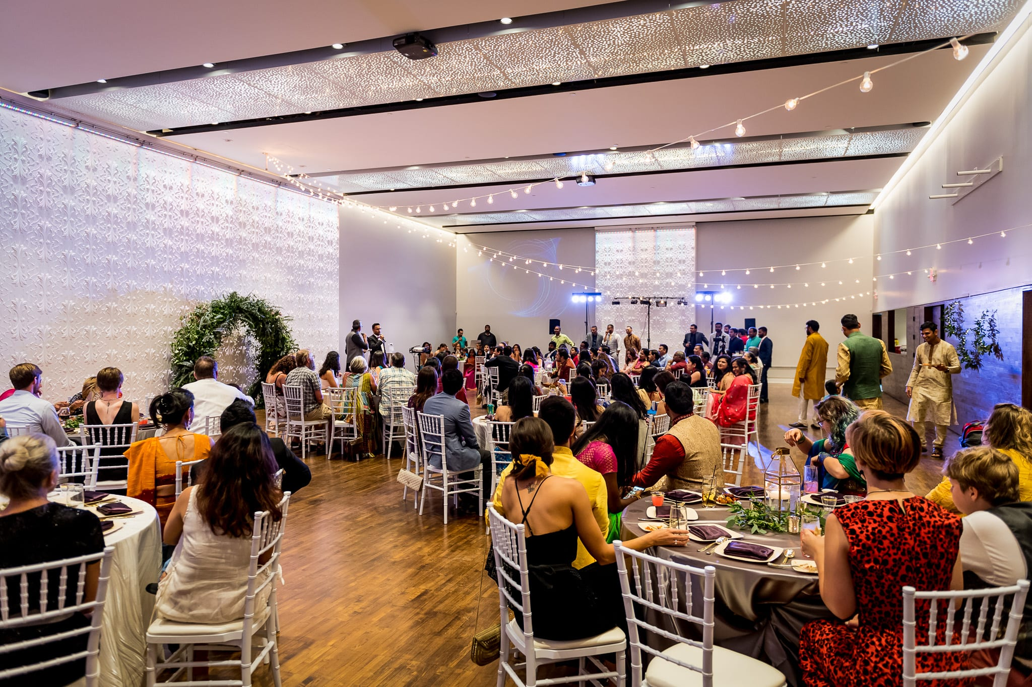 Wide angle shot of the large main room of The Blaisdell during a wedding reception