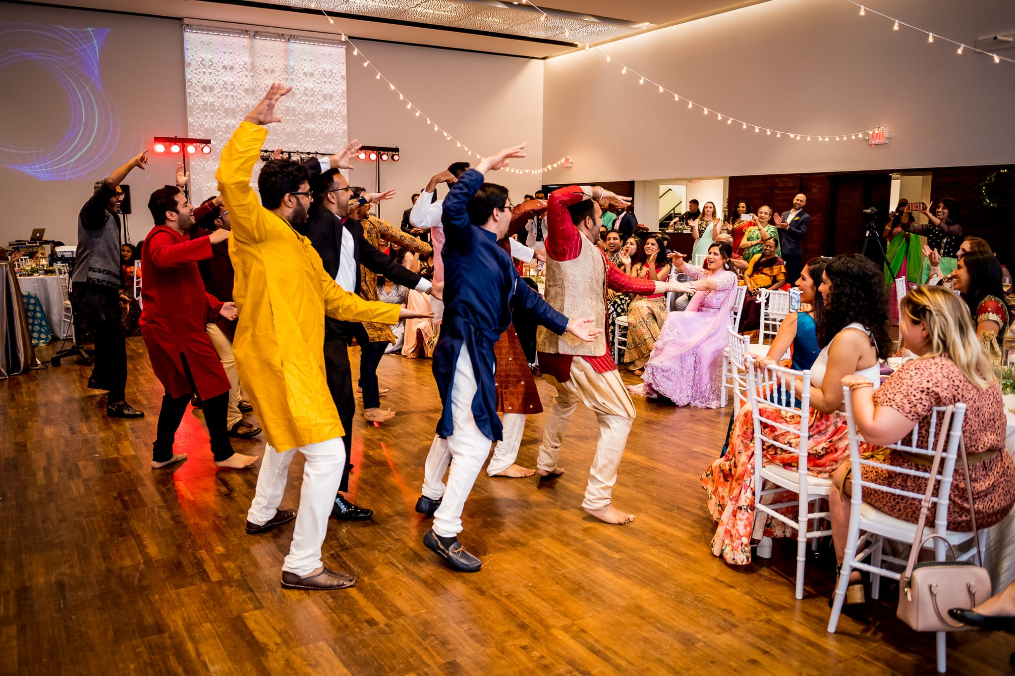 Bride reacted wildly to the groom and his groomsmen performing a choreographed dance at The Blaisdell during their wedding reception