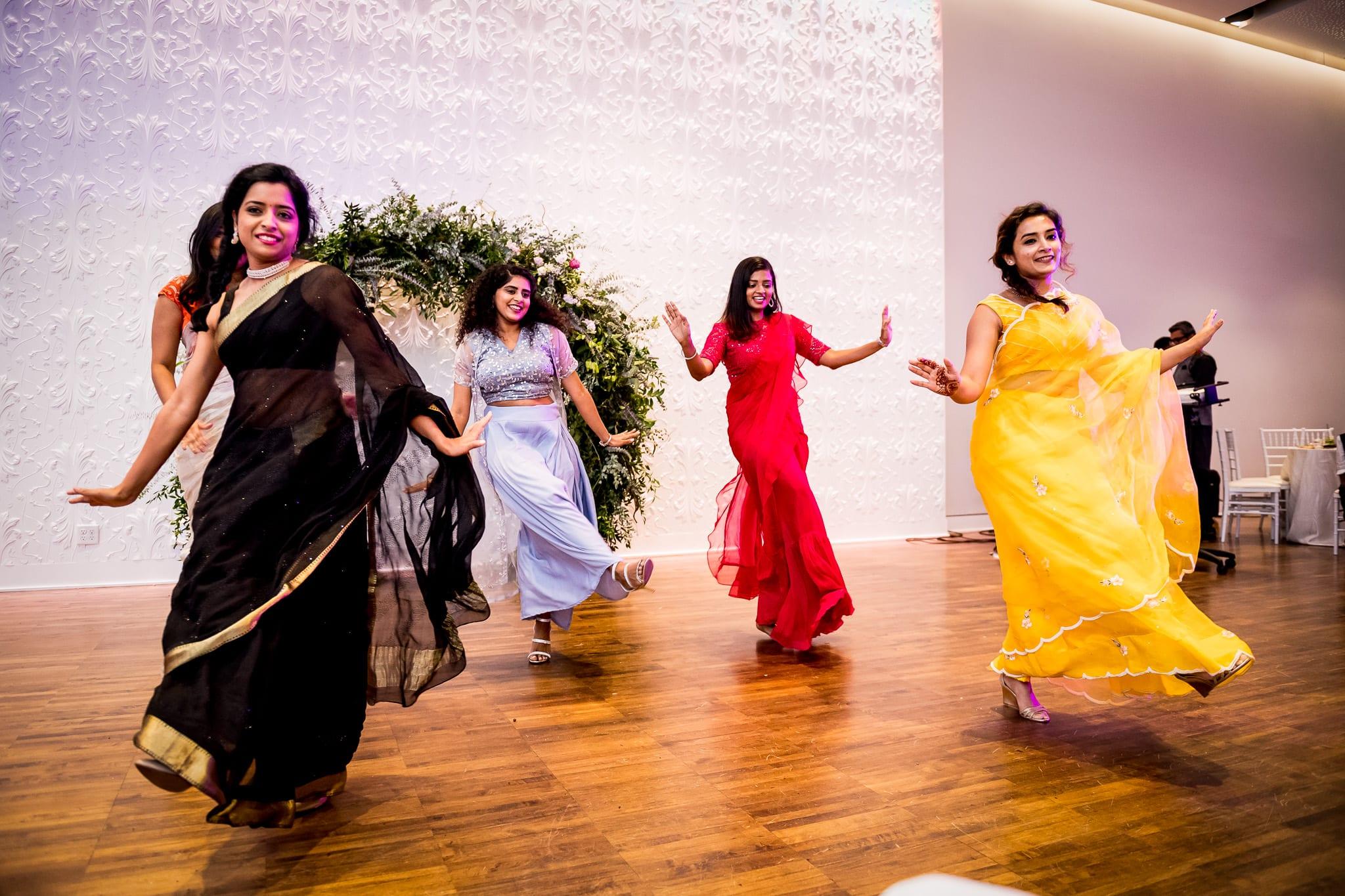 Bridesmaids perform a choreographed dance