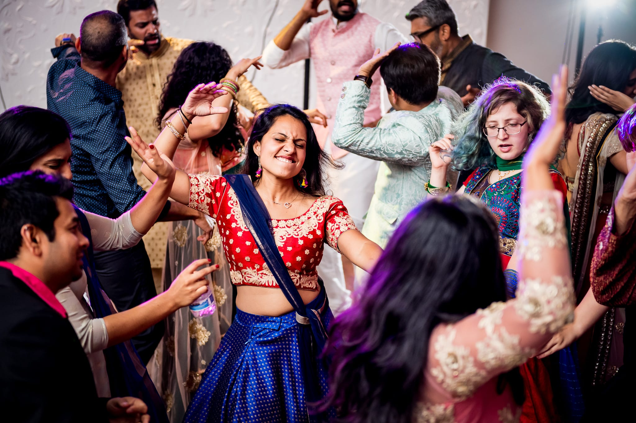 Wedding guest passionately dancing during wedding reception at The Blaisdell
