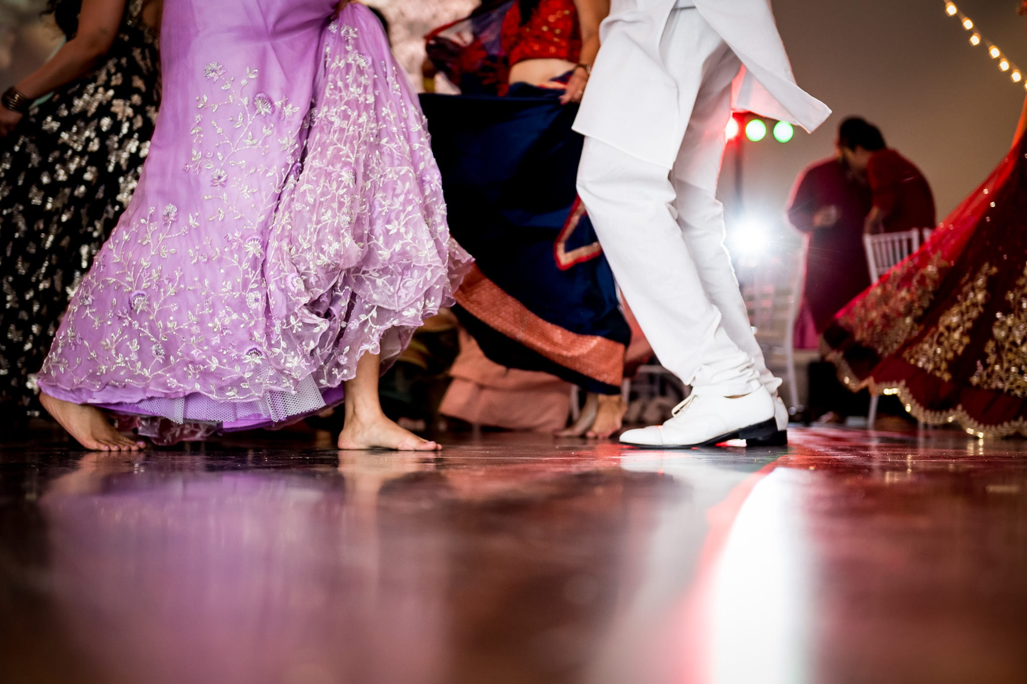 Bride and grooms feet reflecting off the shiny dance floor